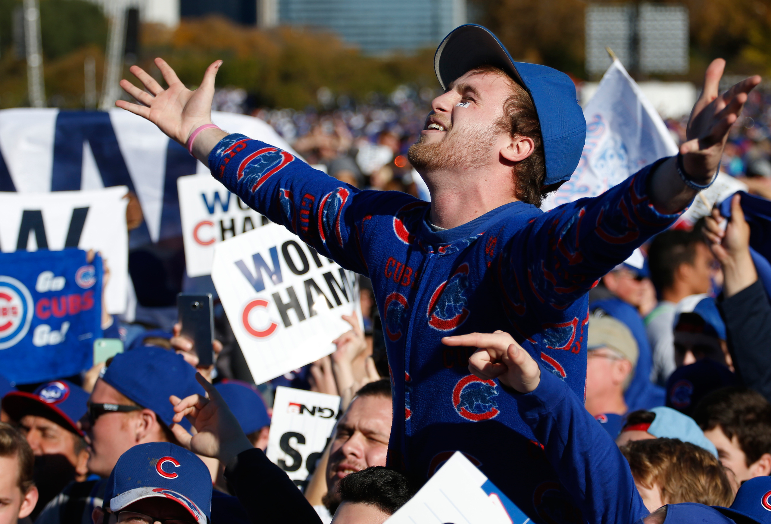 Chicago Cubs fans celebrate before a rally in Grant Park honoring the World Series baseball champions in Chicago on Nov. 4, 2016.