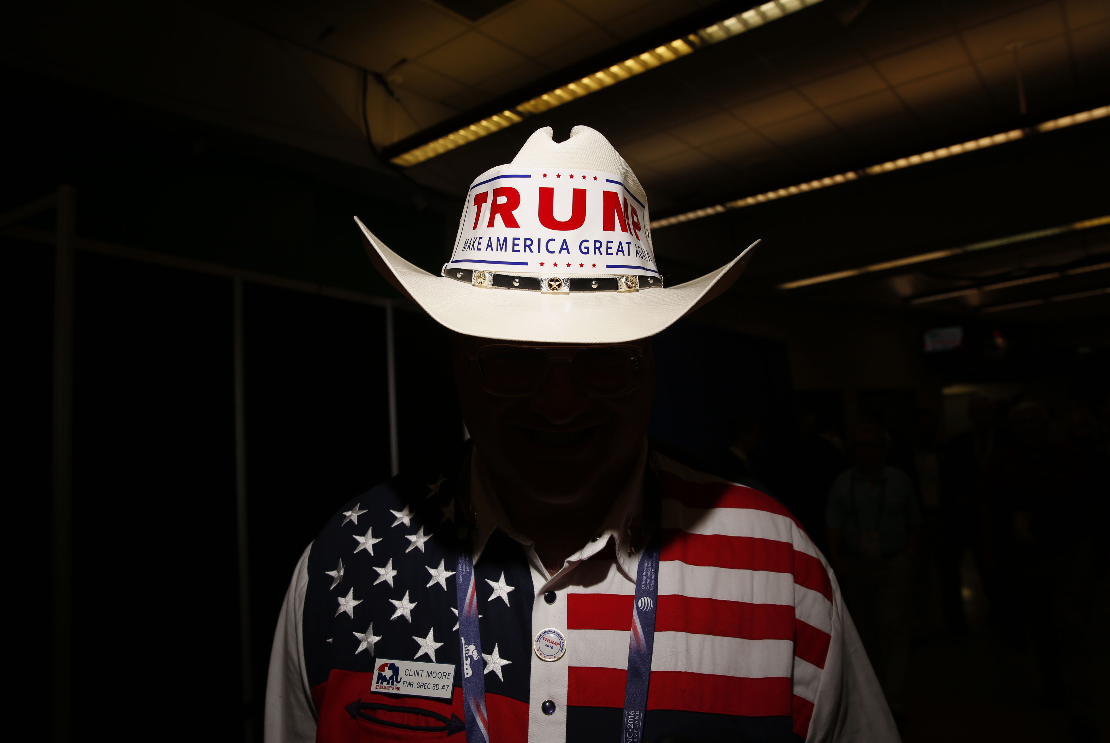 A delegate from Texas wears a cowboy hat with a campaign bumper sticker for Donald Trump during the Republican National Convention in Cleveland, Ohio, on July 20, 2016.