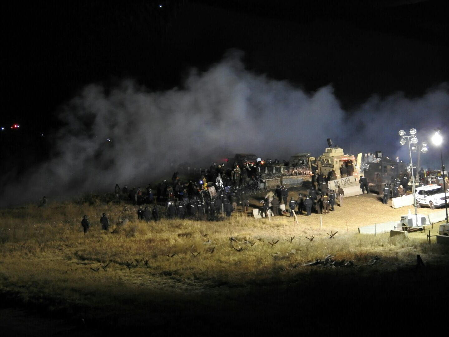 In this image provided by Morton County Sheriff's Department, law enforcement and protesters clash near the site of the Dakota Access pipeline on Nov. 20, 2016, in Cannon Ball, N.D.