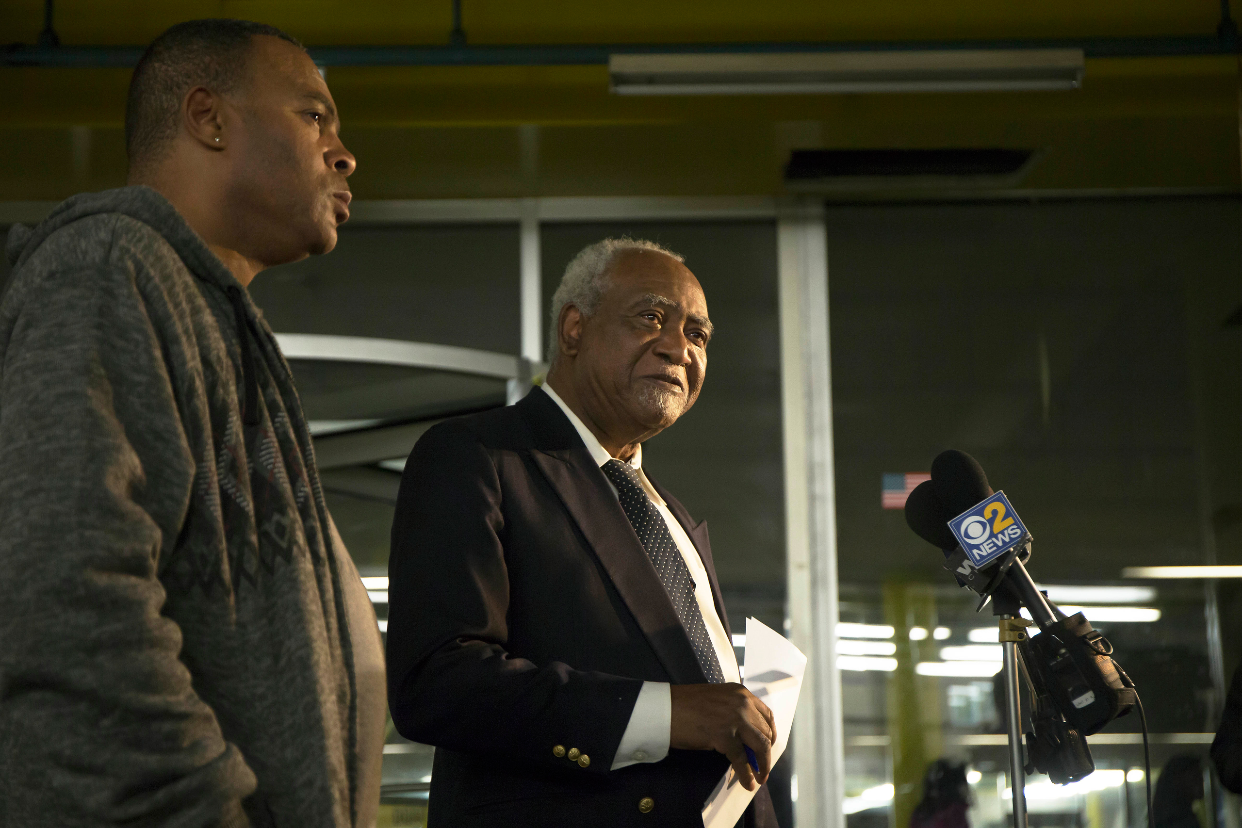 Rep. Danny Davis, D-Ill., center, and his son, Stacey Wilson, give a news conference at the 5th District police department in the Englewood neighborhood of Chicago on Nov. 18, 2016.