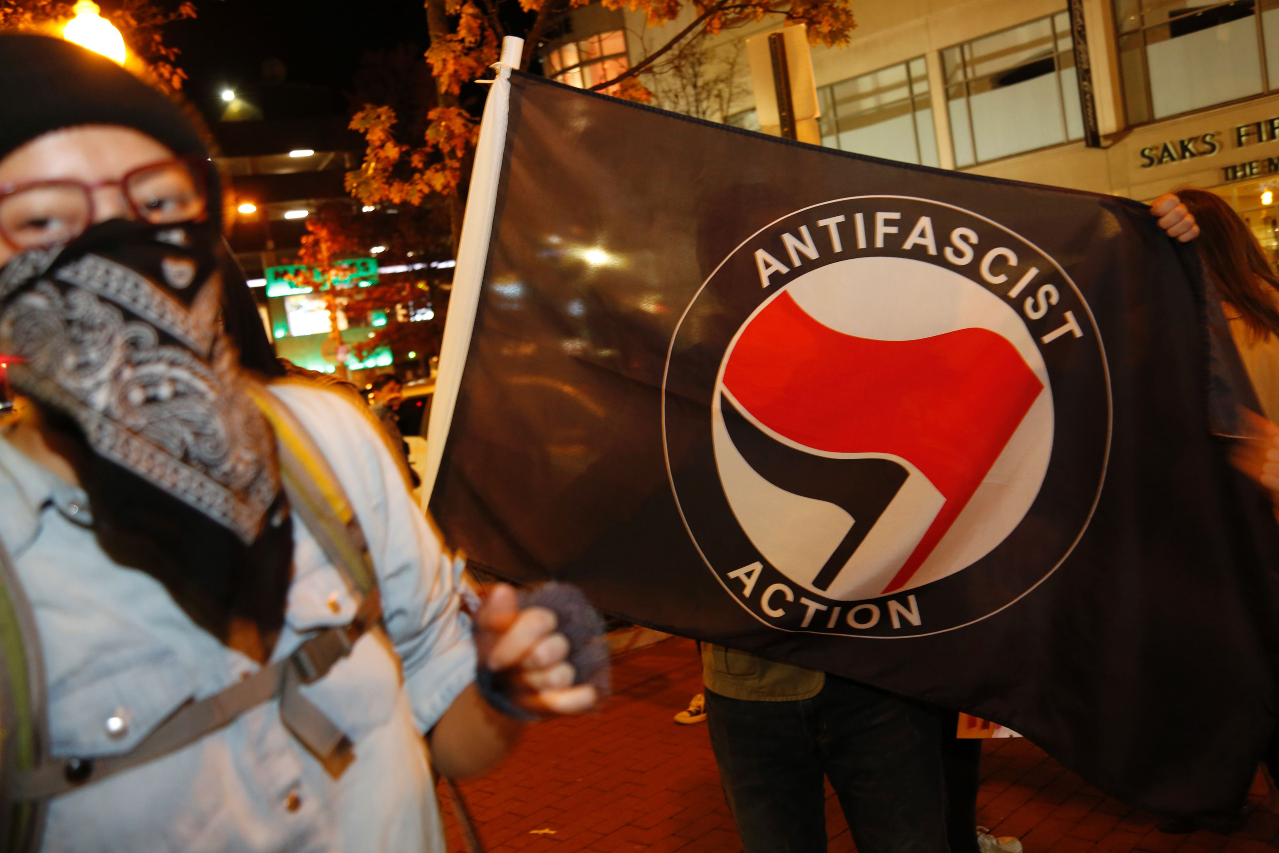 Members of D.C. Antifascist Coalition protest in opposition to a conference by the National Policy Institute in front of the Magliano's restaurant in Washington, D.C., on Nov. 18, 2016