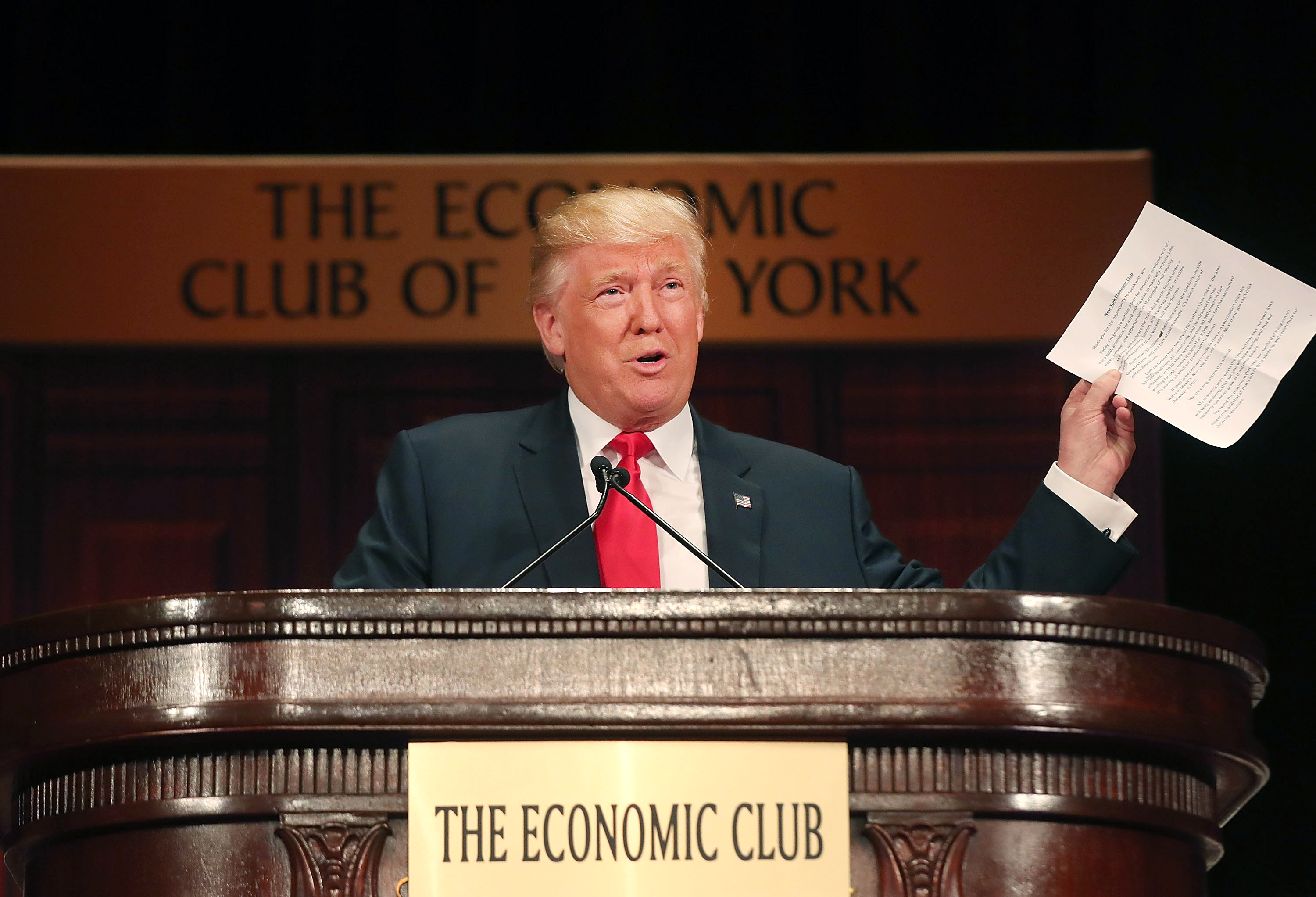 Republican presidential candidate Donald Trump speaks at a lunch hosted by the Economic Club of New York on September 15, 2016 in New York City. According to a report by Oxford Economics, if Trump is elected to the White House growth in the US would be about 5 per cent lower than would otherwise be expected by 2021.