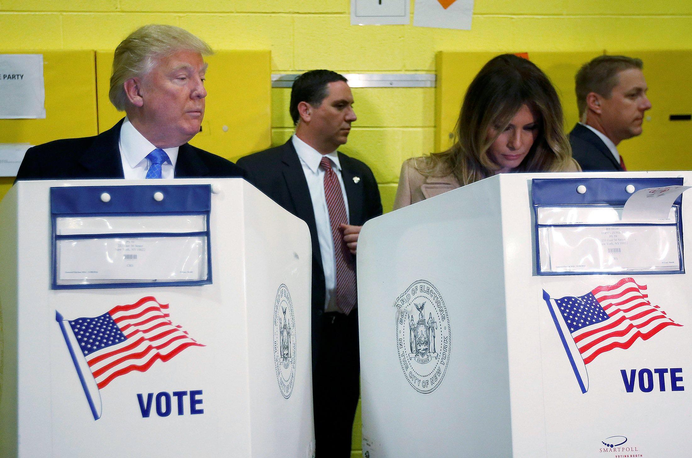 Republican presidential nominee Donald Trump and his wife Melania Trump vote at PS 59 in New York, New York, U.S. November 8, 2016.   REUTERS/Carlo Allegri