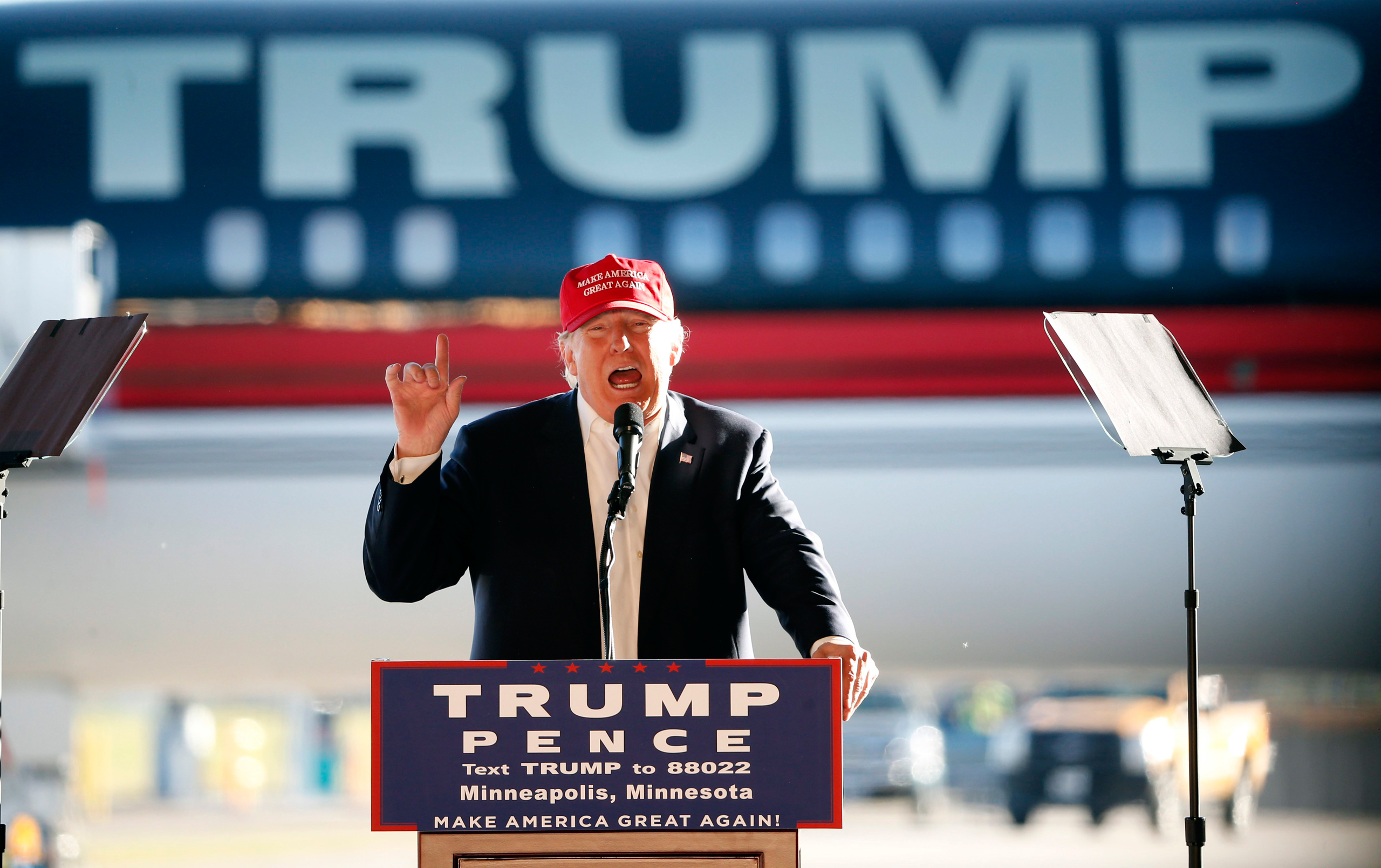 Donald Trump addresses the crowd during a campaign stop at the Minneapolis International Airport in Minneapolis on Nov. 6, 2016.