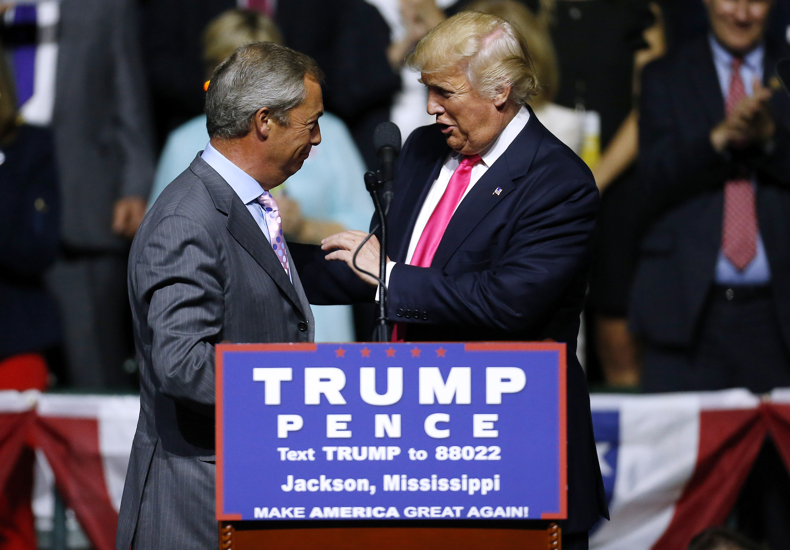 Donald Trump greets United Kingdom Independence Party leader Nigel Farage during a campaign rally at the Mississippi Coliseum on Aug. 24, 2016.