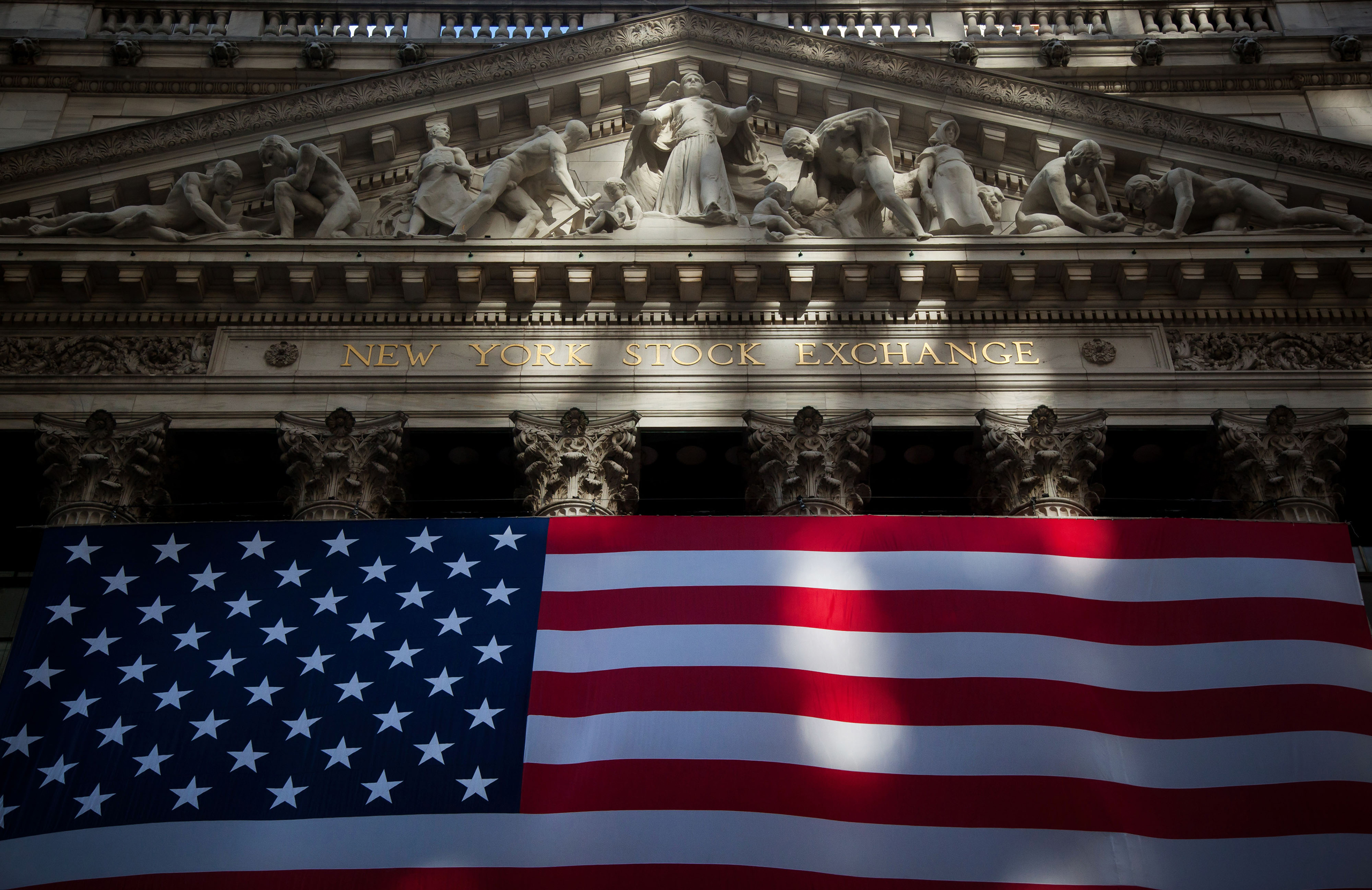 An American flag is displayed at the New York Stock Exchange (NYSE) in New York, U.S., on Nov. 11, 2016.