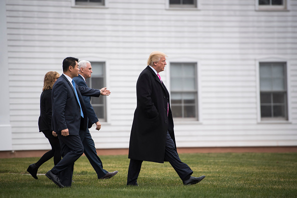 President-elect Donald Trump and Vice President-elect Mike Pence walk out from Lamington Presbyterian Church after attending services in Bedminster Township, N.J. on Sunday, Nov. 20, 2016.