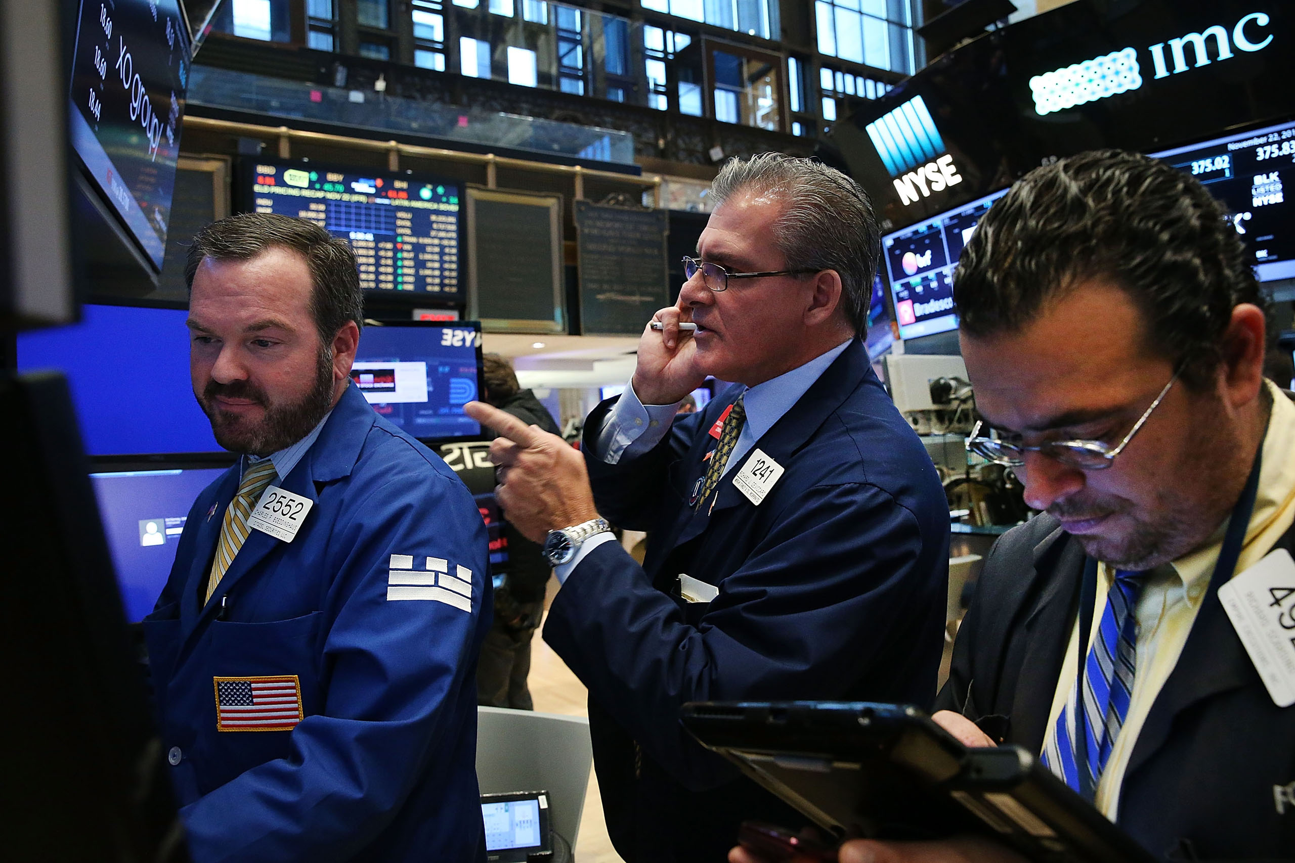 Traders work on the floor of the New York Stock Exchange (NYSE) on November 22, 2016.