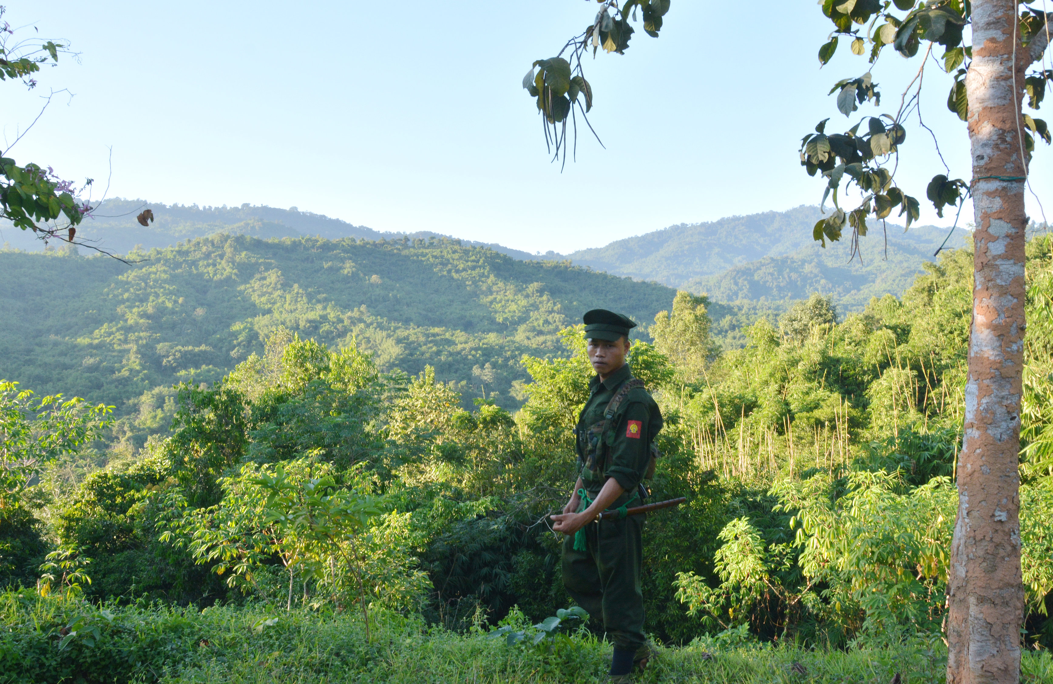 A Kachin Independence Army (KIA) soldier seen at Lawa Yang front-line post. The Burma army is stationed on the hills in the background.