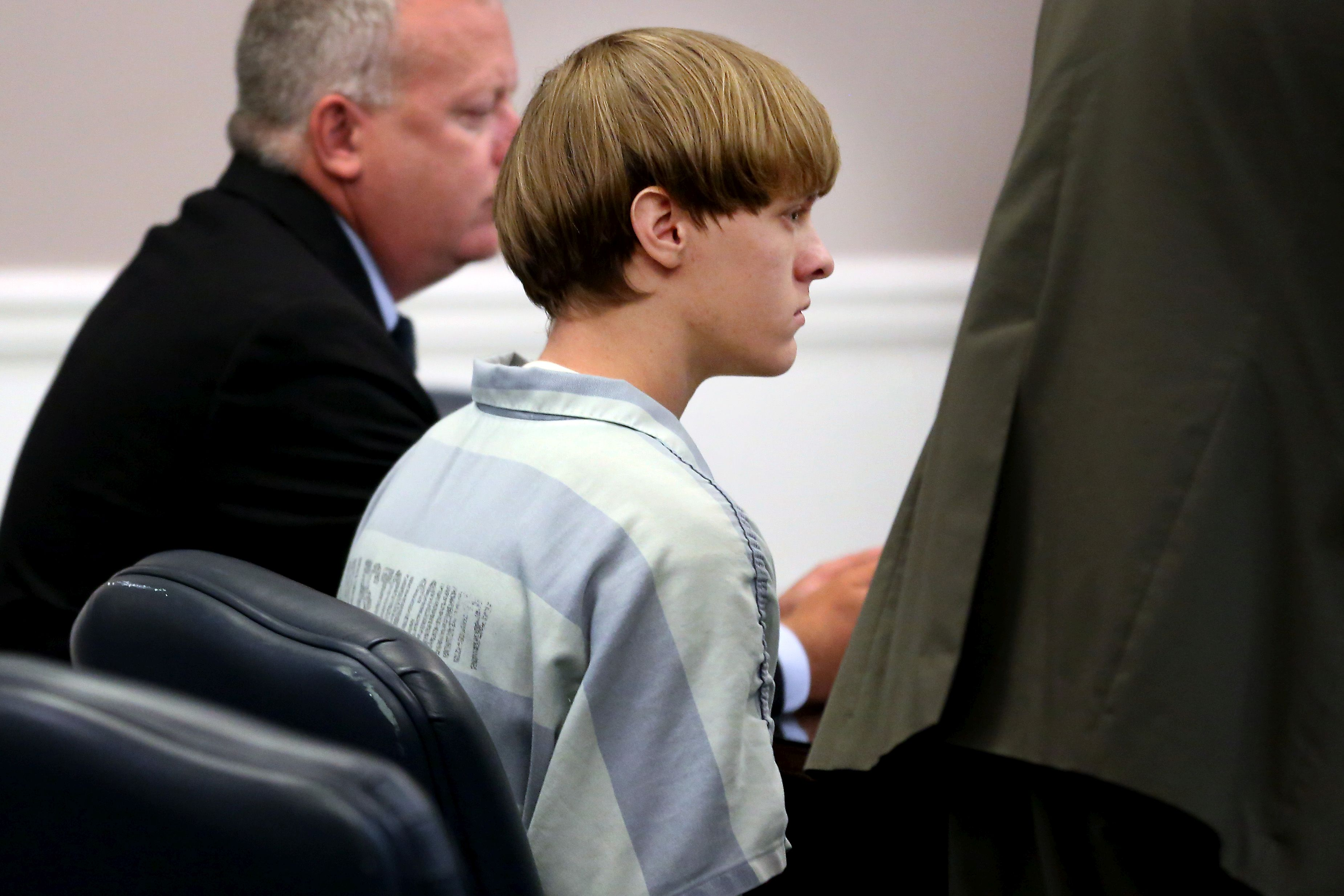 Dylan Roof (C), the suspect in the mass shooting that left nine dead in a Charleston church appears in court in Charleston, S.C., on July 18, 2015.
