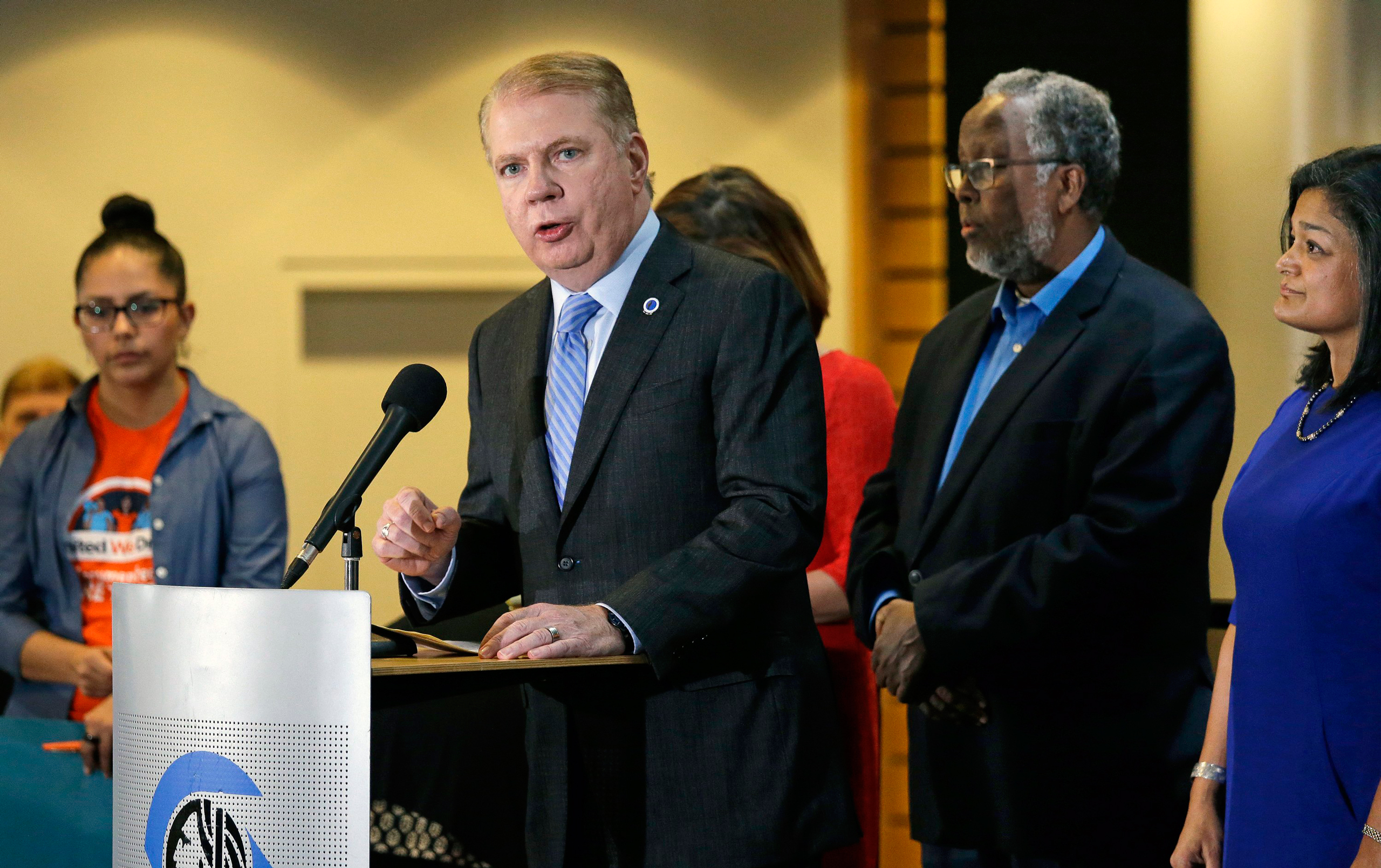 Seattle Mayor Ed Murray, second left, speaks at a post-election event of elected officials and community leaders at City Hall in Seattle on Nov. 9, 2016.