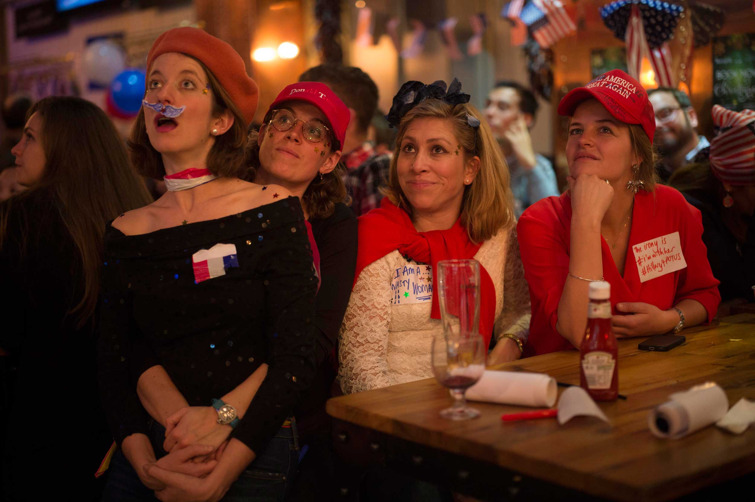 Democrats Abroad, the official Democratic Party arm for Americans living outside the U.S., at the Marylebone Sports Bar and Grill watch the U.S. election unfold. London, Nov. 9, 2016.