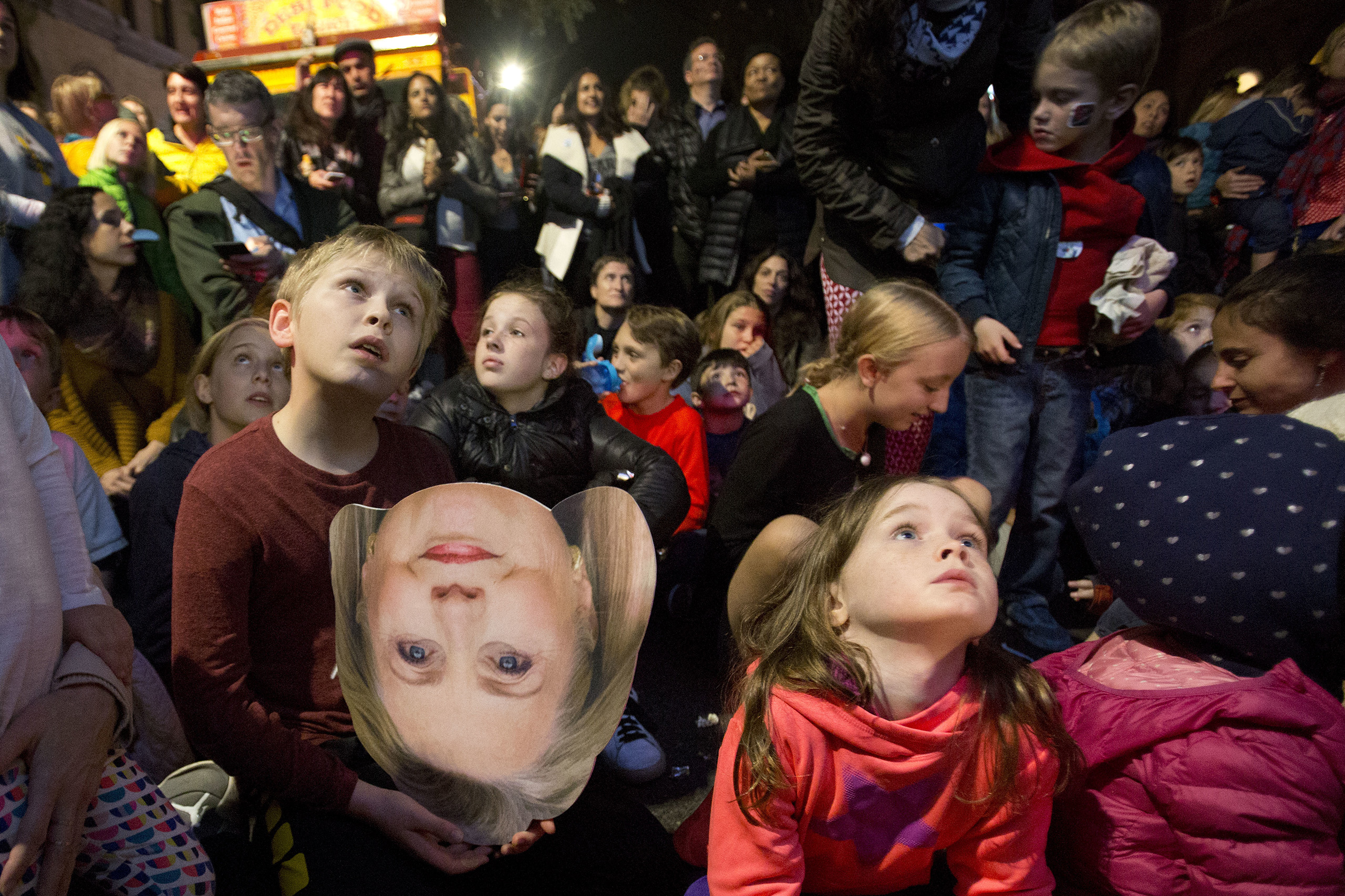 A boy holds a photo of  Hillary Clinton during an election-night block party in the Carroll Gardens neighborhood, in the in the Brooklyn borough of New York City on Nov. 8, 2016