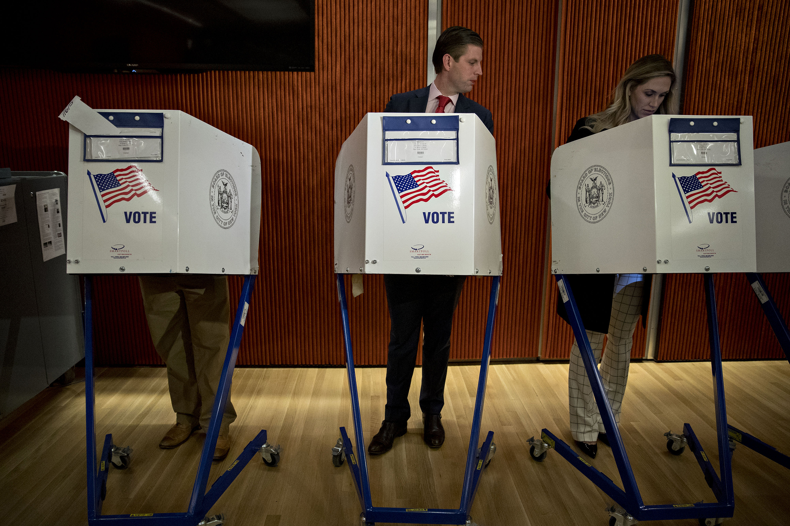 Eric Trump, son of of Republican presidential nominee Donald Trump, looks at his wife Lara's voting booth at the 53rd Street Library in New York, on Nov. 8, 2016.