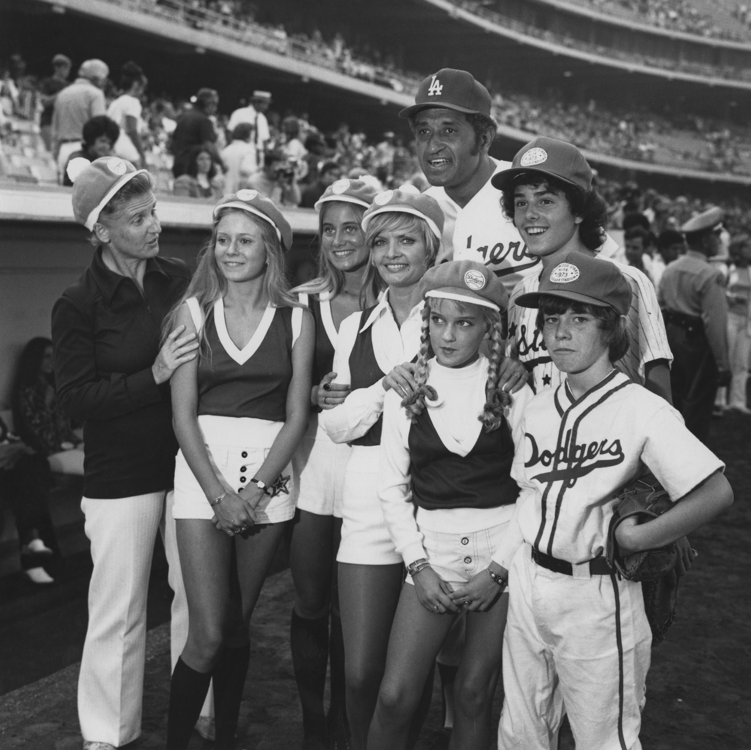 American baseball player Don Newcombe (back, centre) with the cast of the US TV sitcom 'The Brady Bunch', at a charity baseball game at Dodger Stadium, in Los Angeles, in 1973.