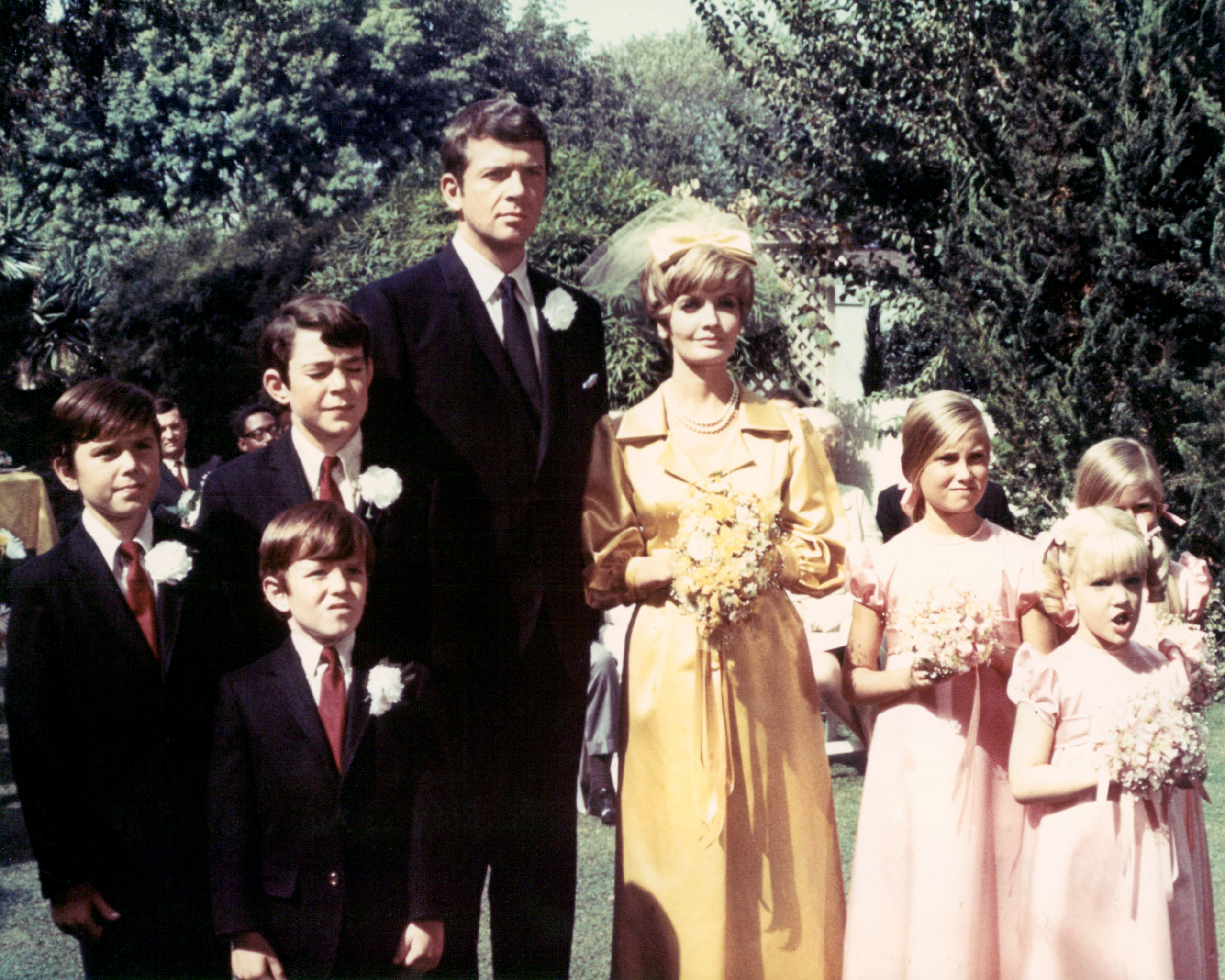 Barry Williams, Christopher Knight, Mike Lookinland, Robert Reed, Florence Henderson, Maureen McCormick, Eve Plumb, and Susan Olsen pose in a group portrait at a wedding in a publicity image issued for the US television series,  The Brady Bunch,  in 1969.