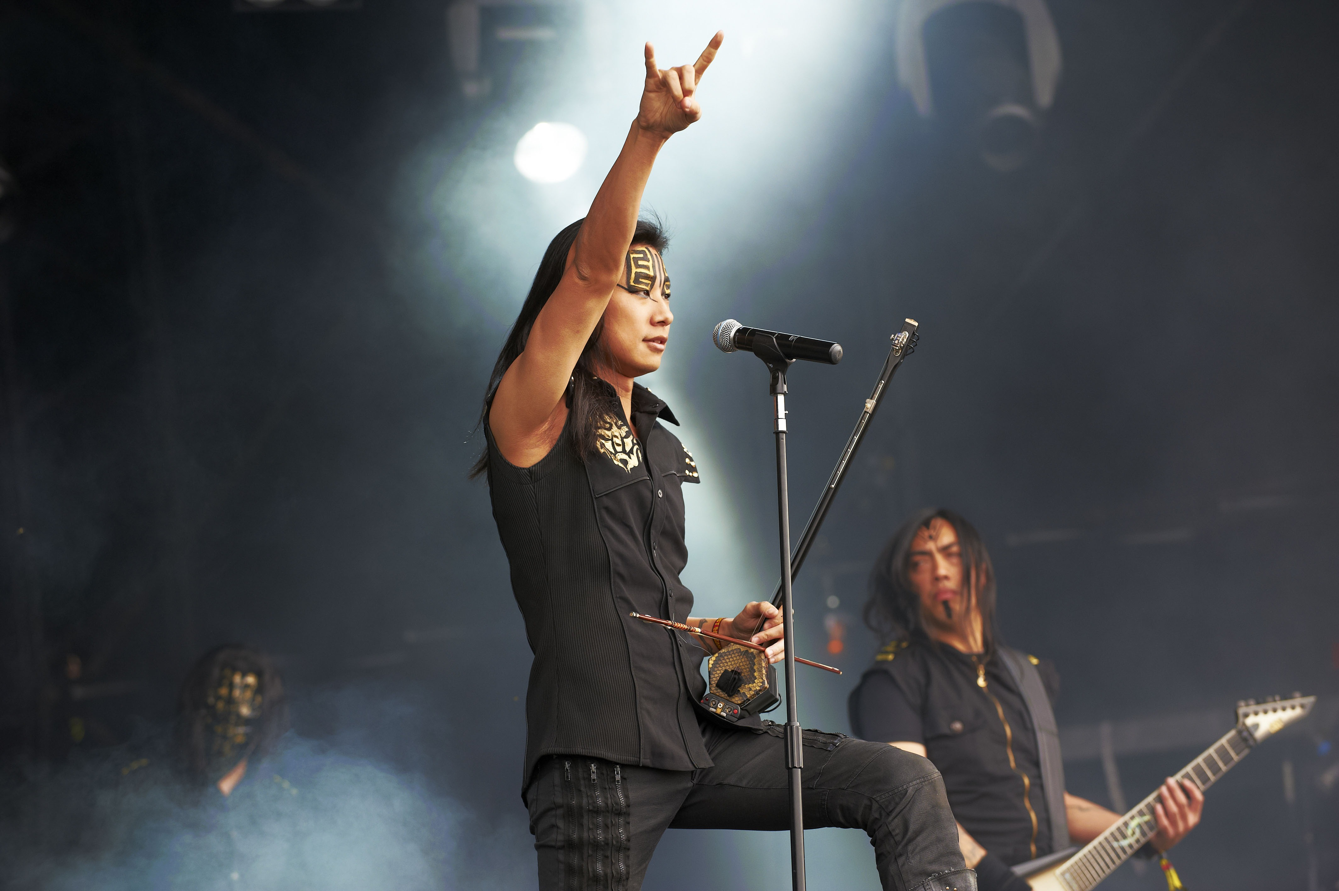 Freddy Lim of Chthonic performs on stage during day 2 of Bloodstock Open Air 2012 at Catton Hall on August 11, 2012 in Derby, England