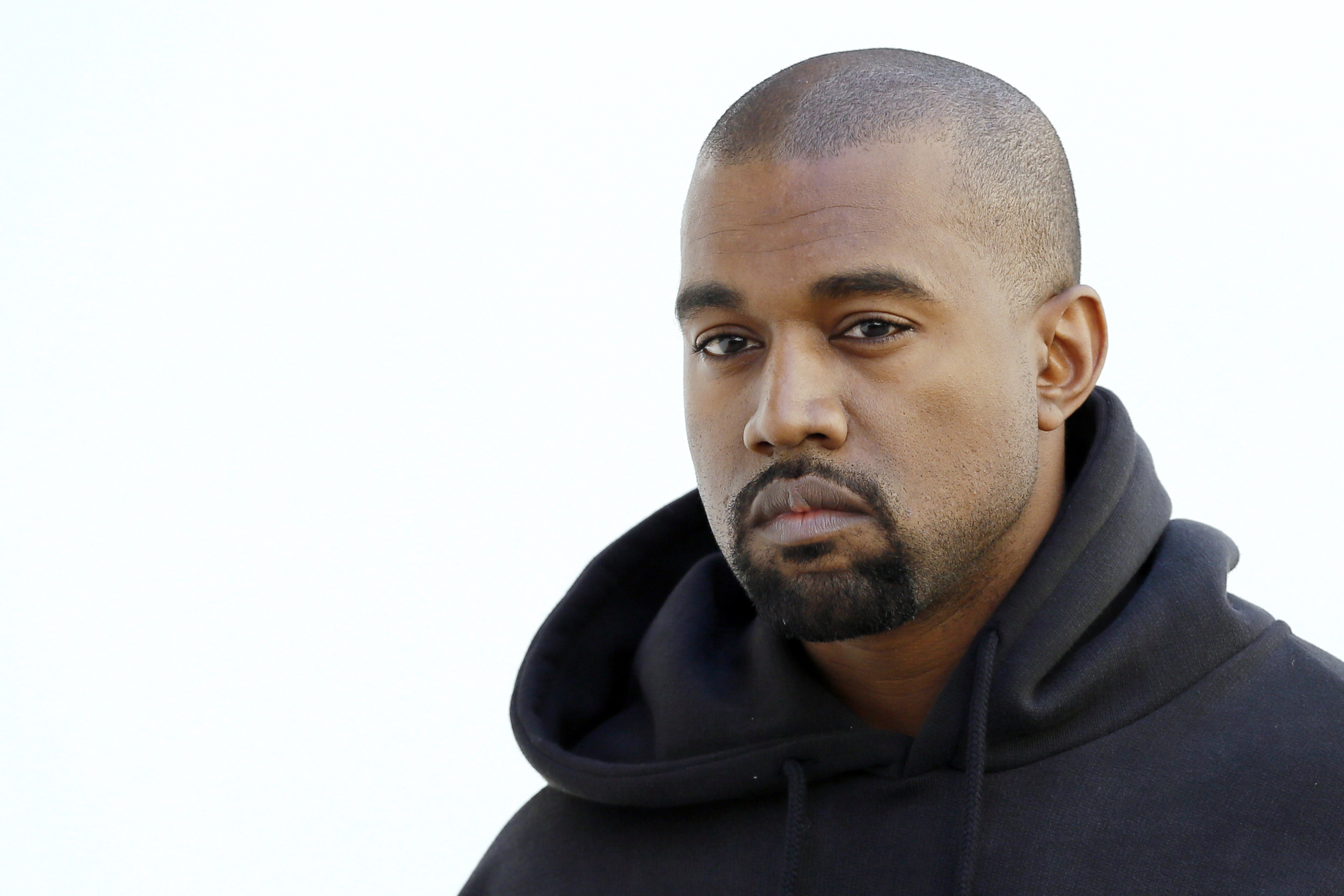 American rapper Kanye West poses before Christian Dior 2015-2016 fall/winter fashion show on March 6, 2015 in Paris.