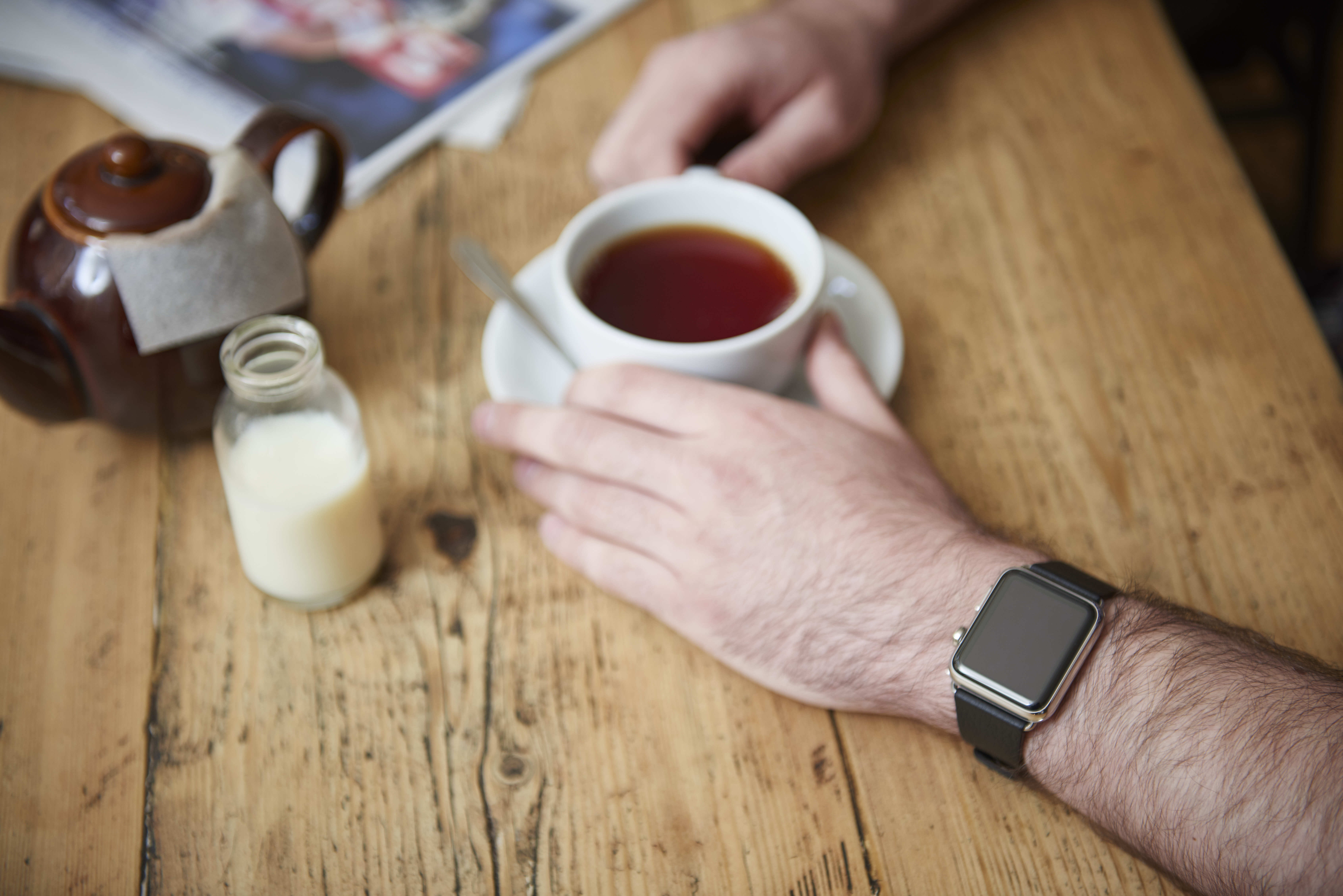 Detail of a man wearing an Apple Watch while sitting inside a cafe, taken on May 21, 2015. (Photo by Joseph Branston/Future Publishing via Getty Images)