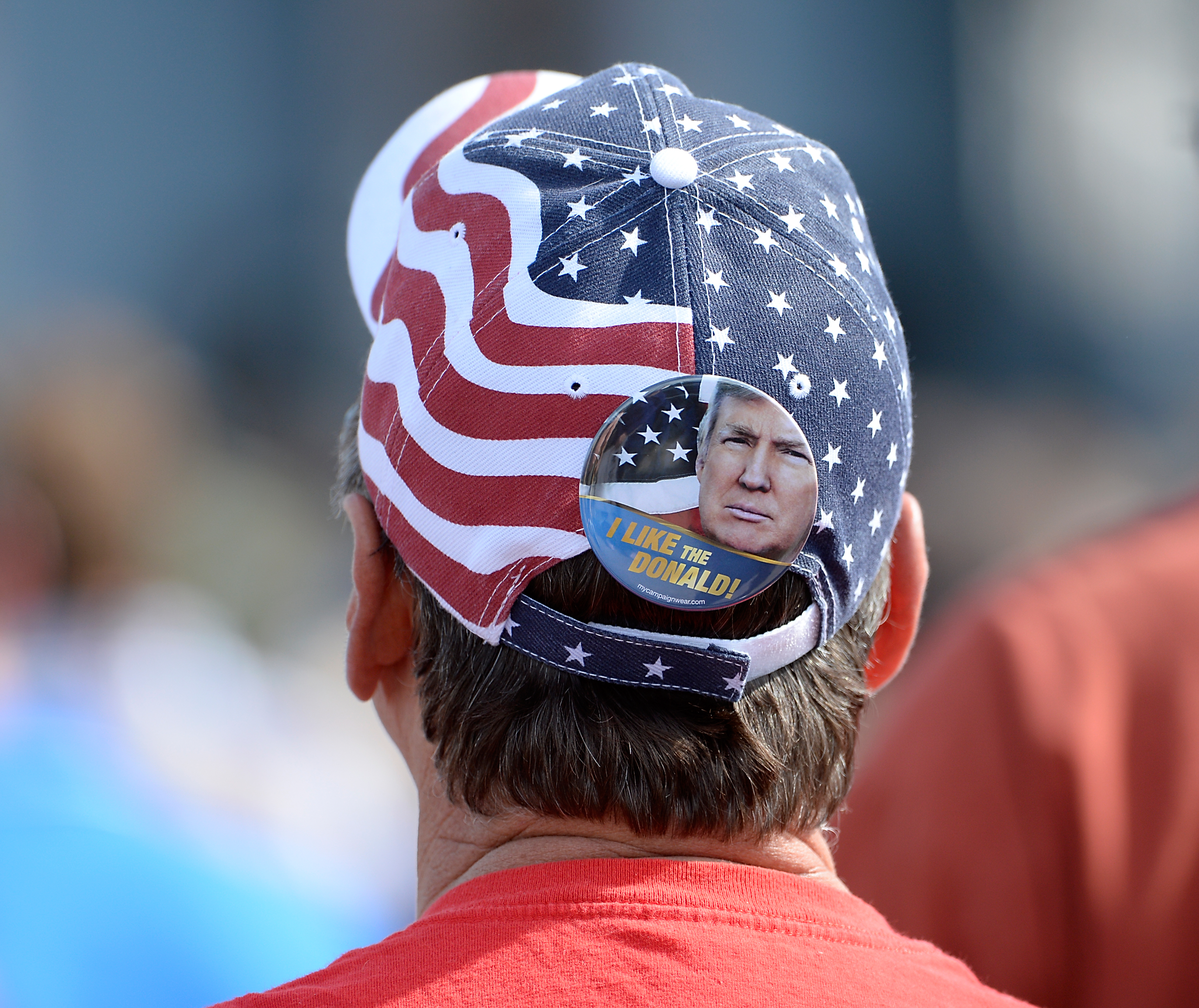 A supporter for Republican presidential candidate Donald Trump wears regalia at a rally on October 31, 2015 in Norfolk, Virginia.