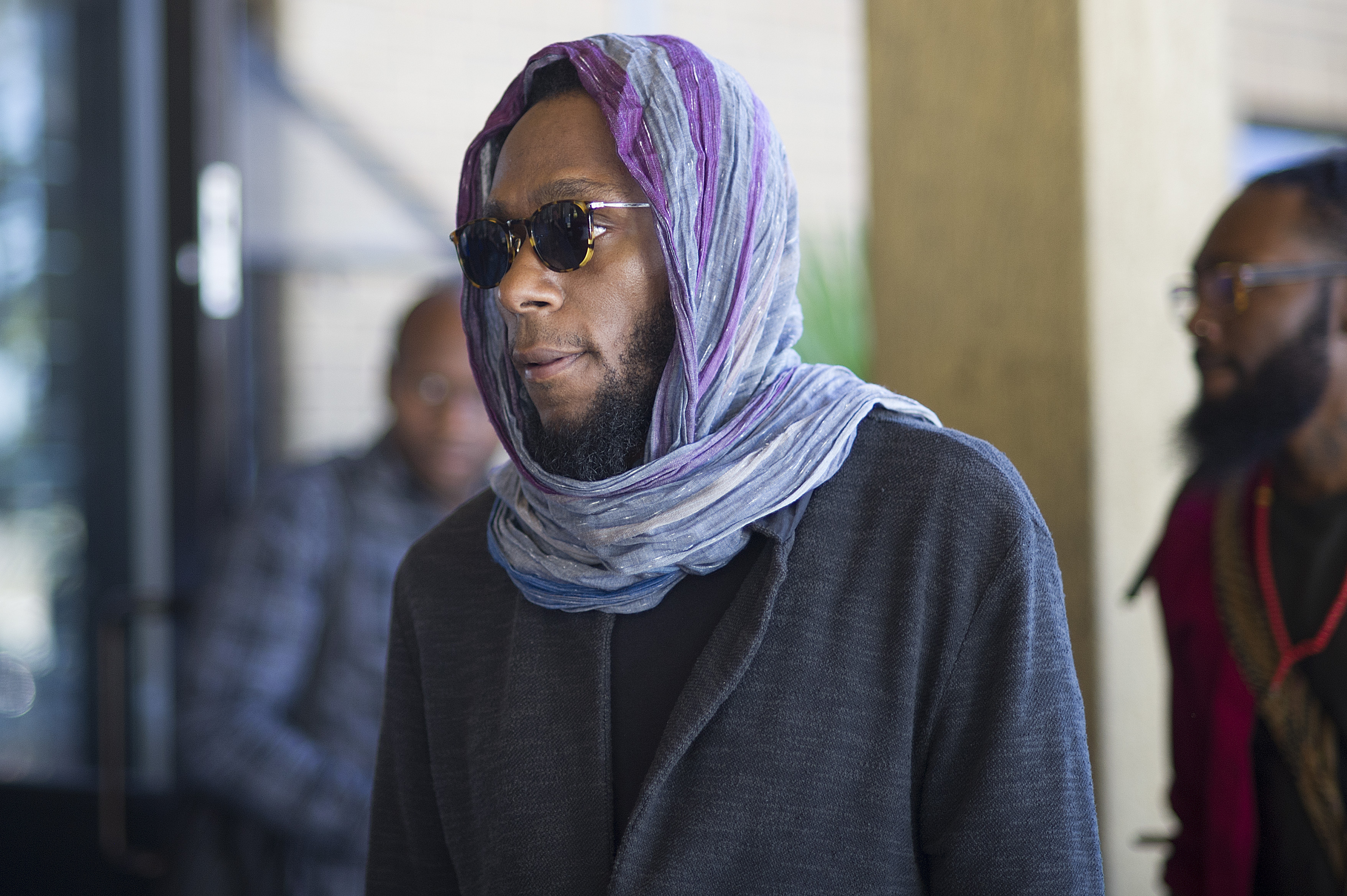 Hip hop artist and actor, Yasiin Bey, known as Mos Def, walks into the Bellville Magistrates Court, to appear for contravening South African immigration laws, on March 8, 2016, in Cape Town.