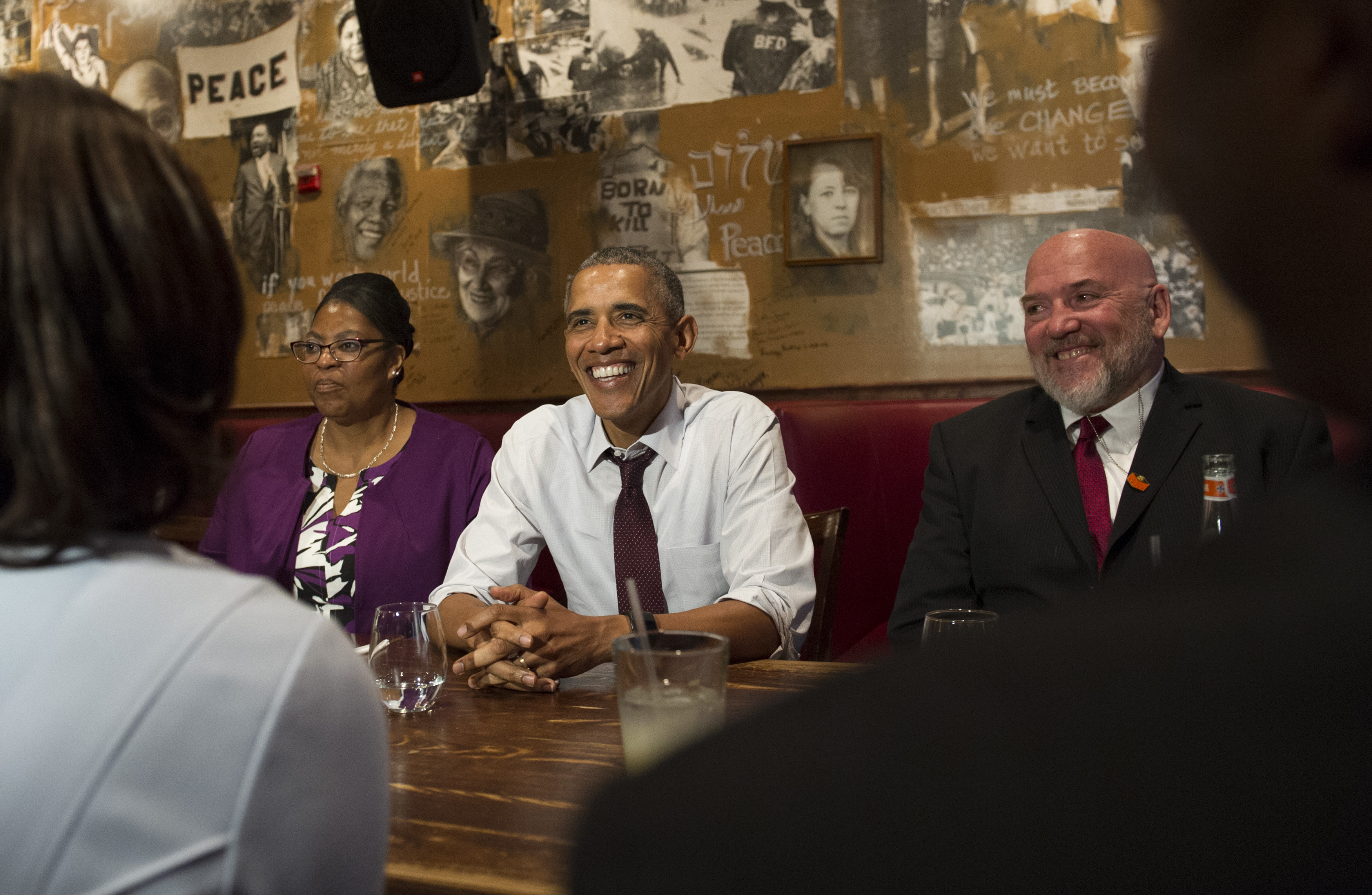 U.S. President Barack Obama speaks to the media after having lunch with formerly incarcerated individuals who have received commutations, including Ramona Brant (L) and Phillip Emmert (R), at Bus Boys and Poets restaurant on March 30, 2016 in Washington, D.C. Pool—Getty Images