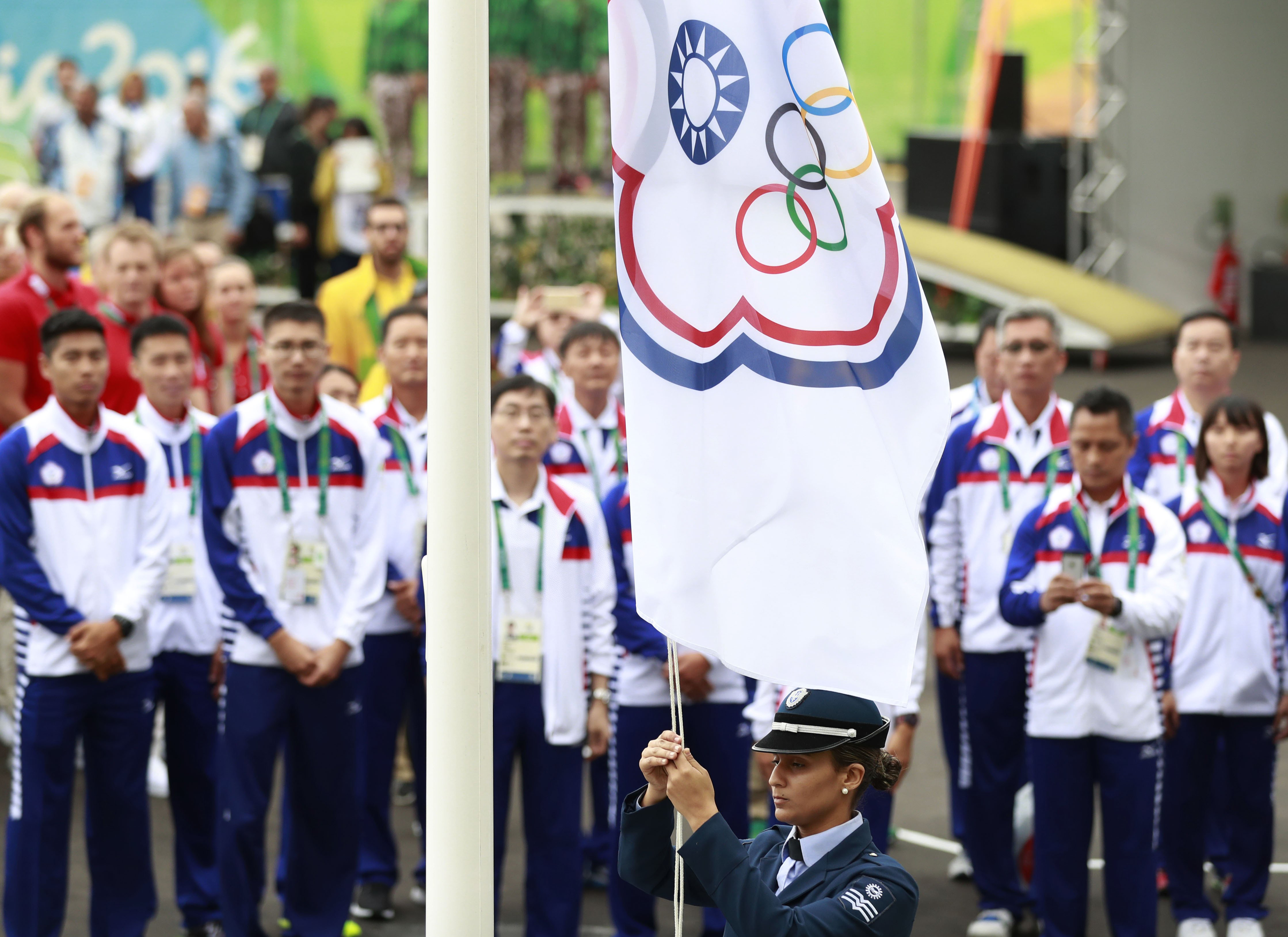 The Taiwanese delegation to the Rio 2016 Olympic Games, competing as Chinese Taipei,  attends the flag-raising ceremony at the Olympic Village in Rio de Janeiro on Aug. 3, 2016