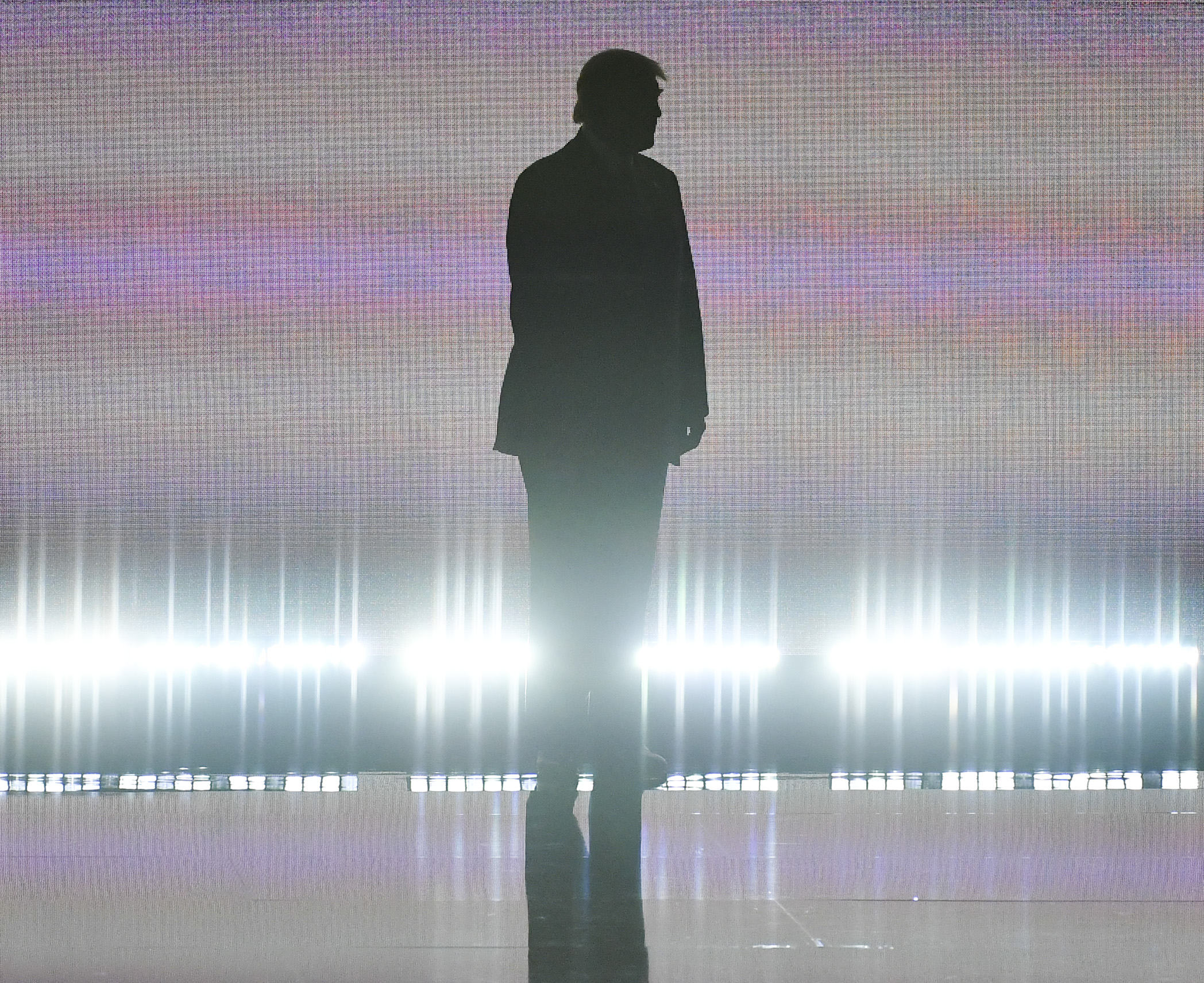 Donald Trump arrives on stage to introduce his wife Melania during the Republican National Convention in Cleveland, Ohio, on July 18, 2016.