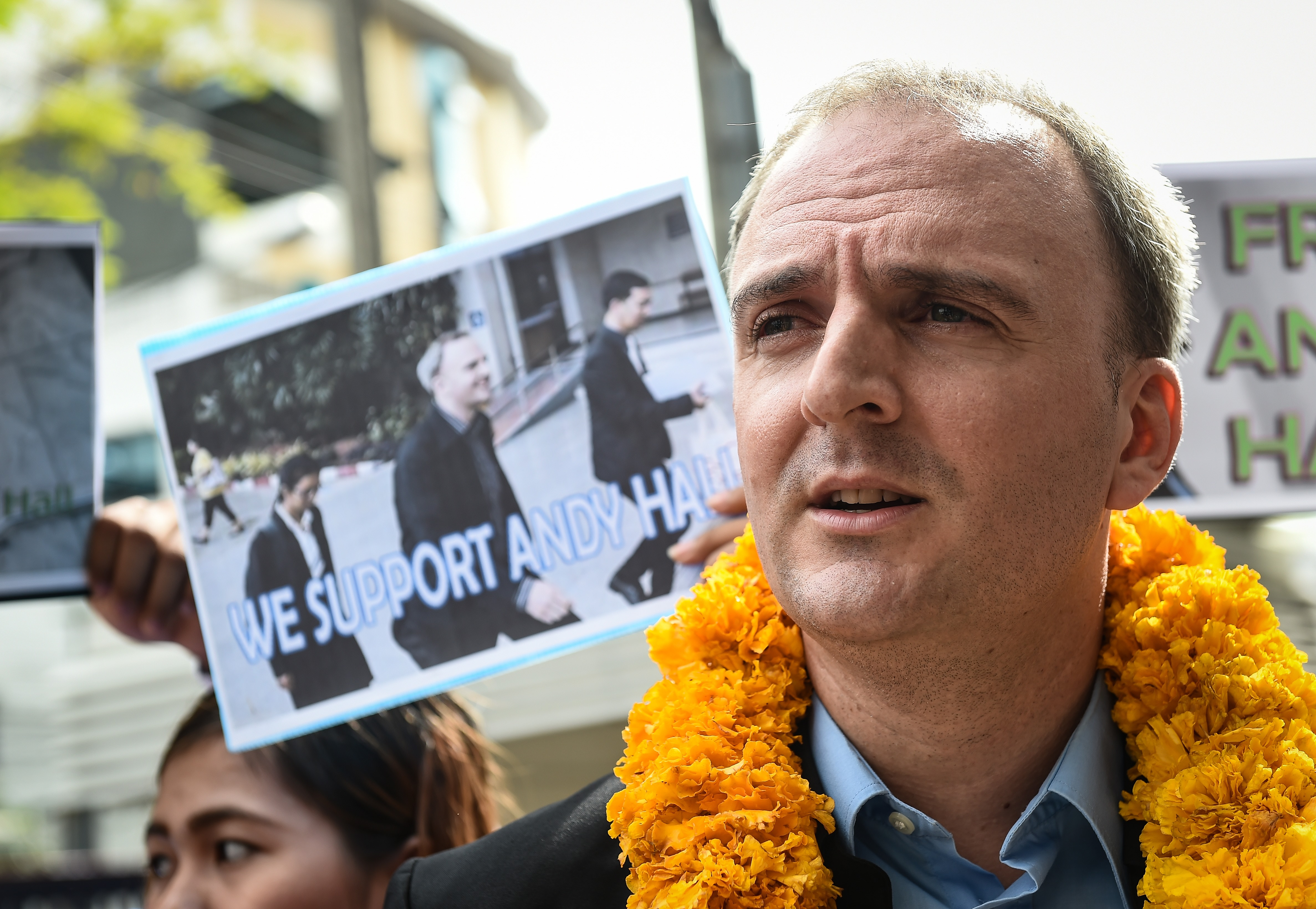 British labour activist Andy Hall speaks to the media as he arrives at the Bangkok South Criminal Court in Bangkok on Sept. 20, 2016