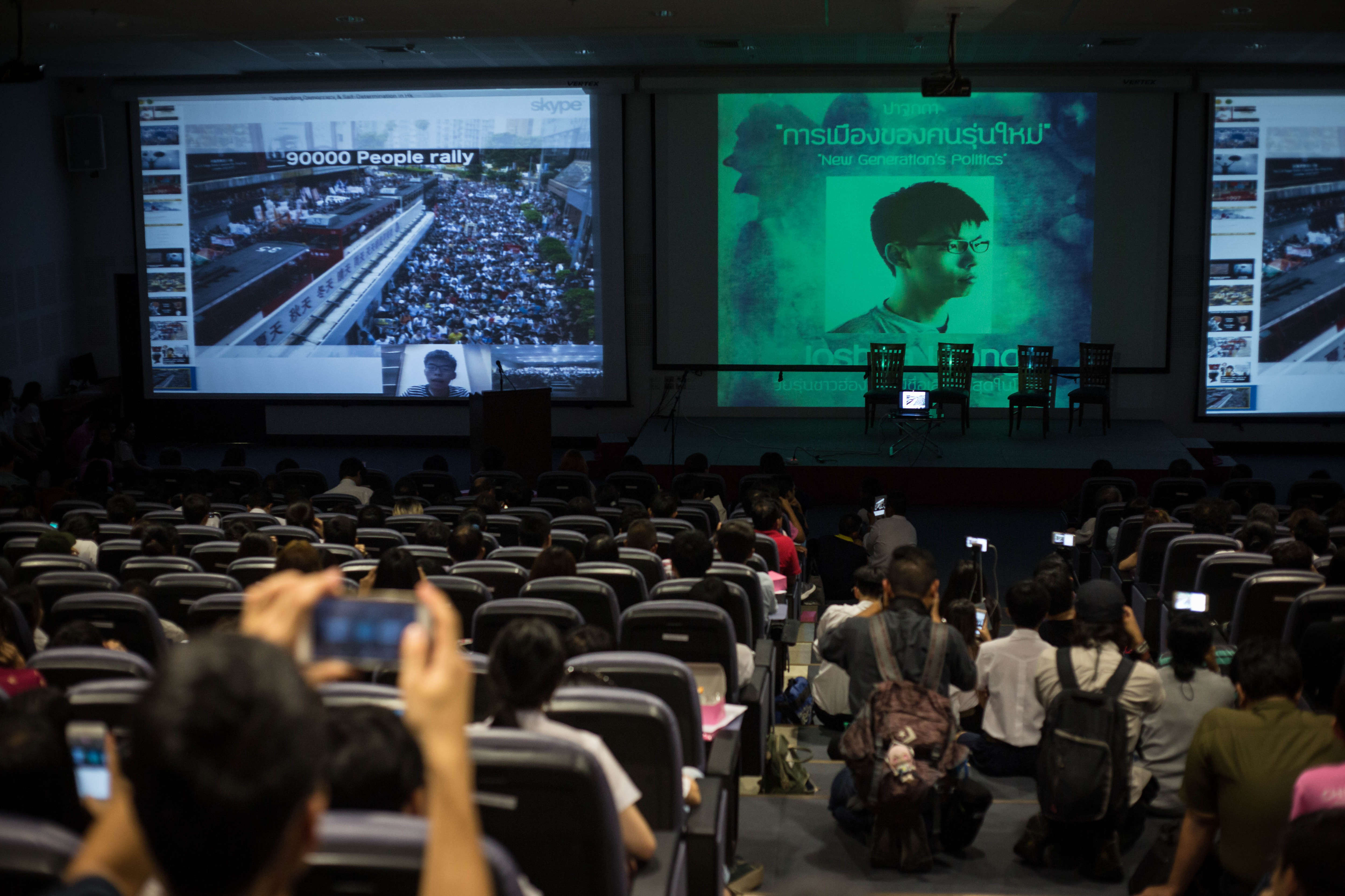 Joshua Wong gives a speech via Skype during an event at the Chulalongkorn University campus in Bangkok on Oct. 6, 2016. He was meant to give his speech in person but was arrested and sent back to Hong Kong one day before by Thai immigration