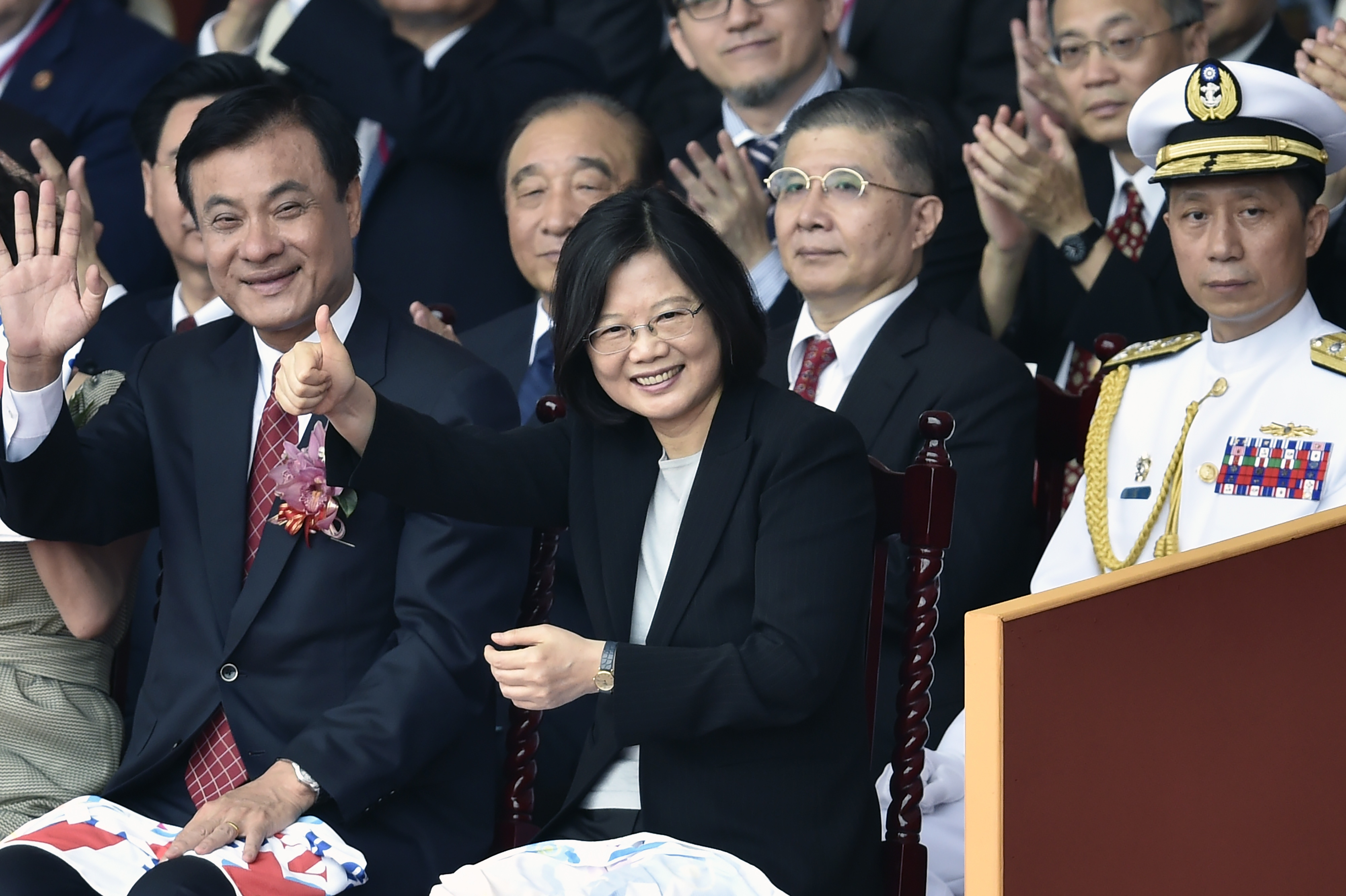 Taiwan President Tsai Ing-wen, center, gestures during National Day celebrations in front of the Presidential Palace in Taipei on Oct. 10, 2016. Relations with Beijing have deteriorated under Taiwan's first female President, whose China-skeptic party, the DPP, took office in May after a landslide victory over the KMT