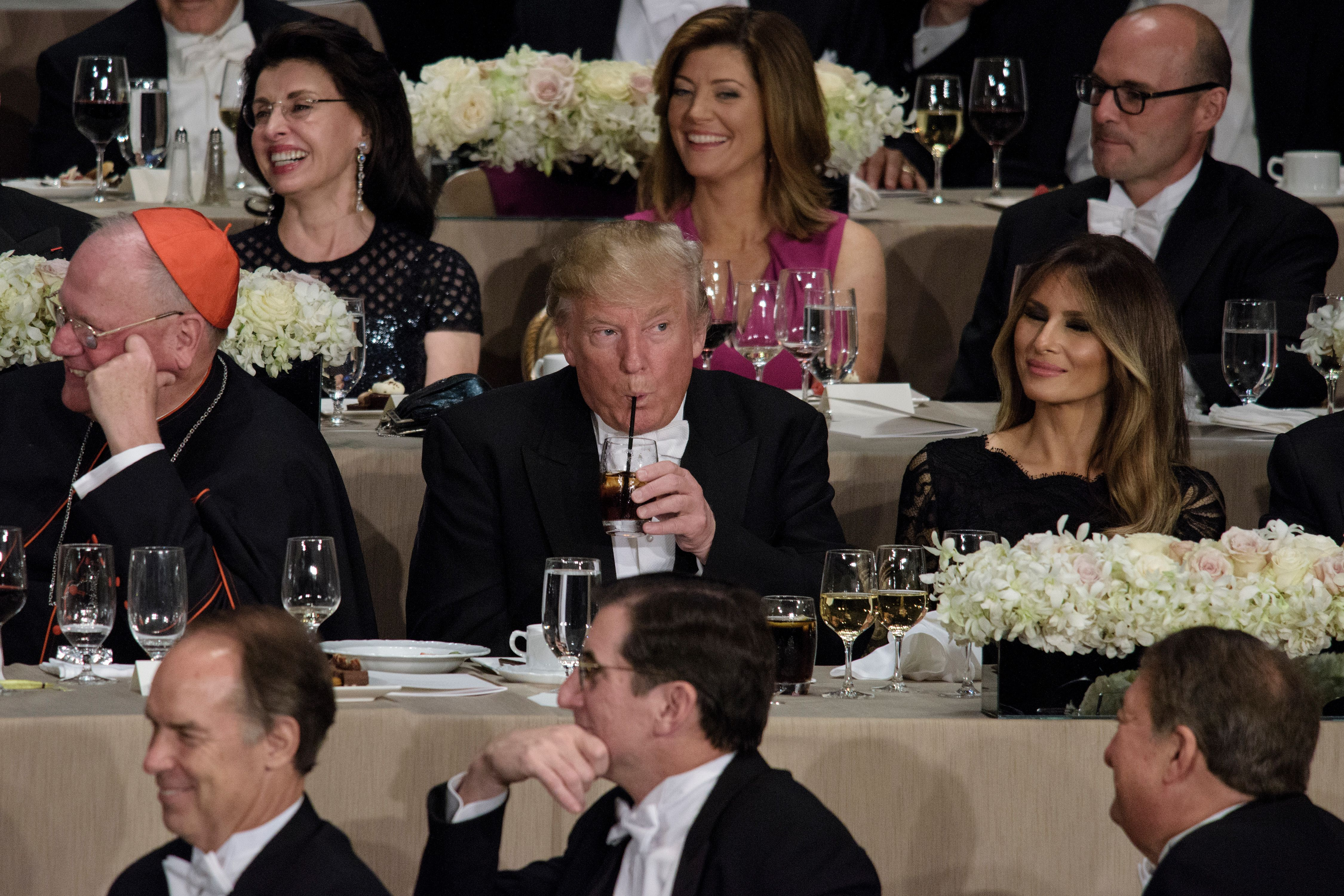 From left Timothy Cardinal Dolan, Archbishop of New York, Donald Trump, Melania Trump and others listen as Democratic presidential nominee Hillary Clinton speaks during the Alfred E. Smith Memorial Foundation Dinner at Waldorf Astoria in New York, New York, on Oct. 20, 2016.