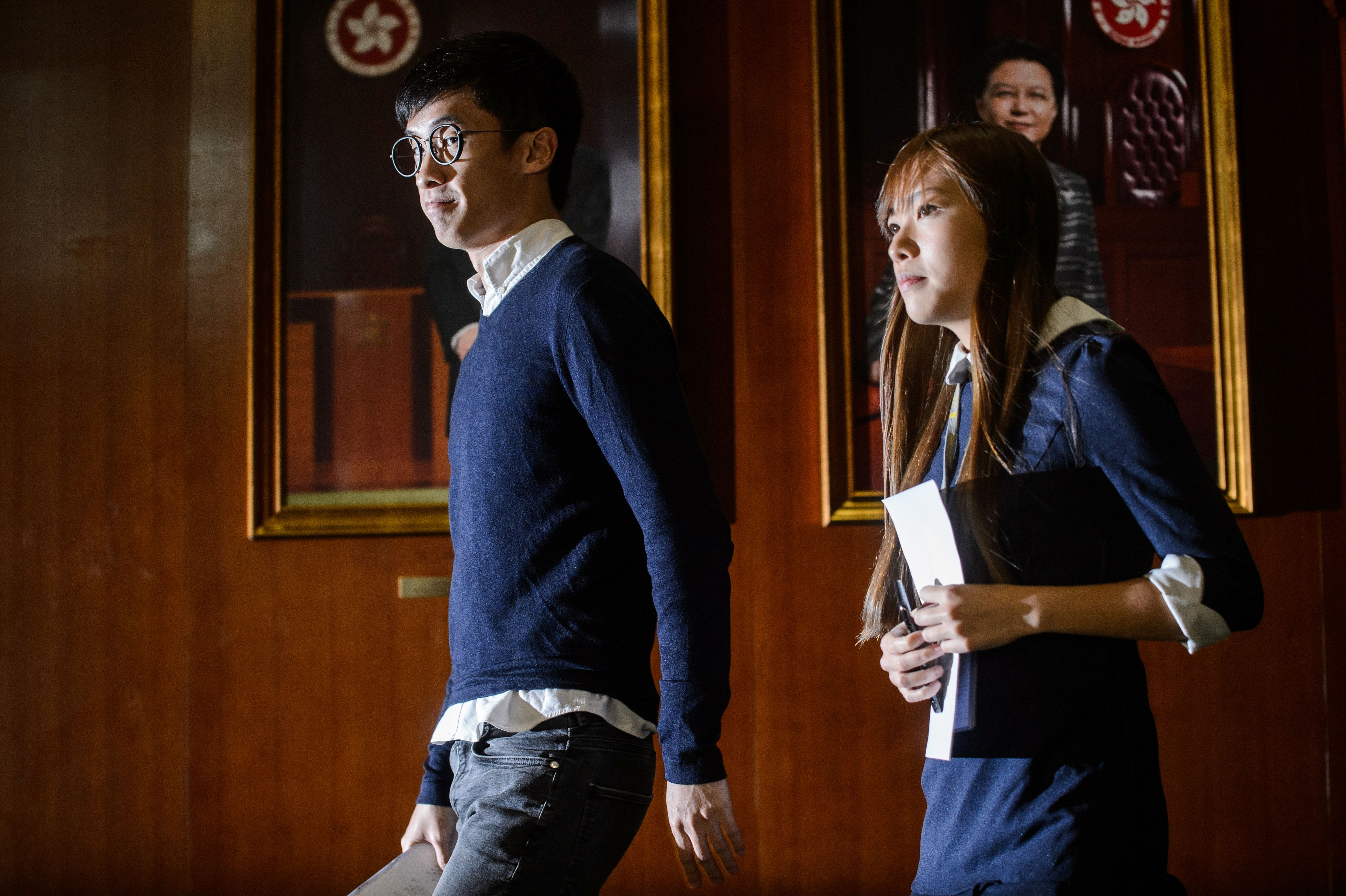 Newly elected pro-independence lawmakers Baggio Leung, left, and Yau Wai-ching arrive before speaking to the press at the Legislative Council in Hong Kong on Oct. 25, 2016
