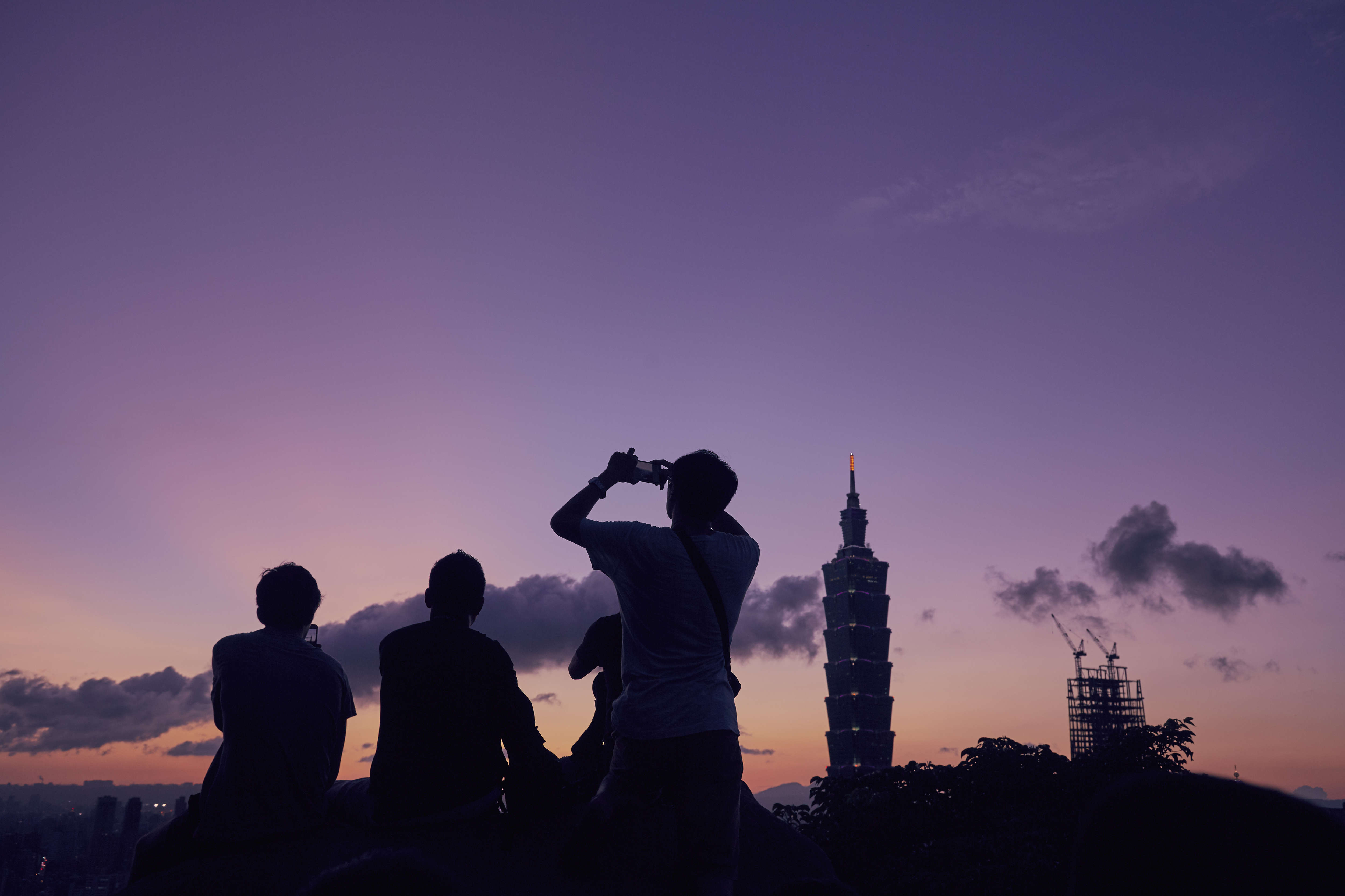 People gather the watch the sunset over Taipei. The Elephant Mountain hiking trail attracts photographers and tourists whenever there's a chance of a nice sunset
