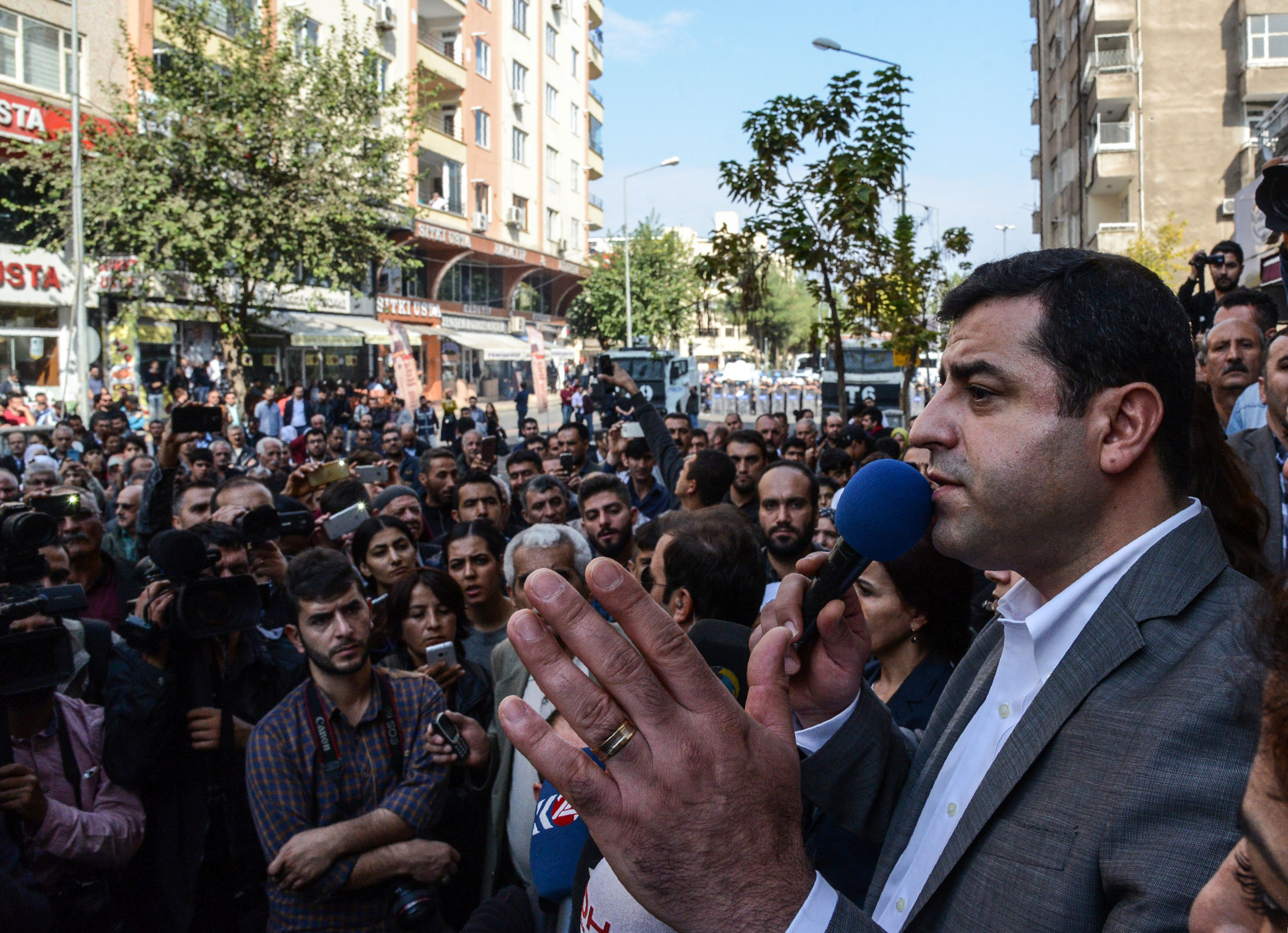 Selahattin Demirtas, Co-leader of the pro-Kurdish Peoples Democracy Party (HDP), addresses participants of a pro-Kurdish demonstration in front of the municipality headquarters in Diyarbakir, southeastern Turkey, Oct. 30, 2016.