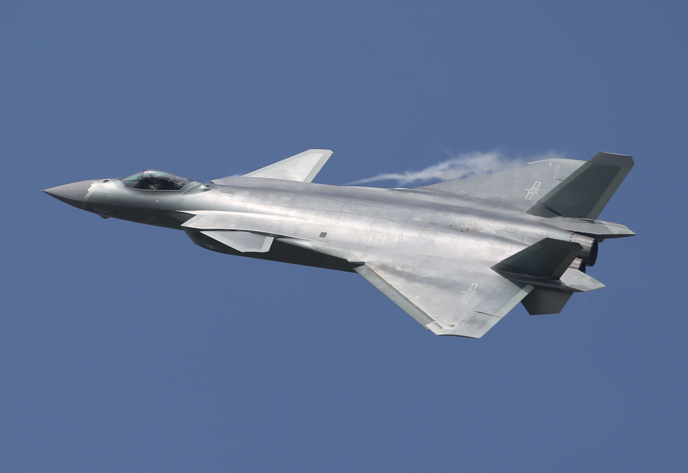 The J-20 fighter aircraft, produced by Chengdu Aerospace Corporation, flies during the 11th China International Aviation & Aerospace Exhibition at Zhuhai Airshow Center on November 1, 2016 in Zhuhai, China.