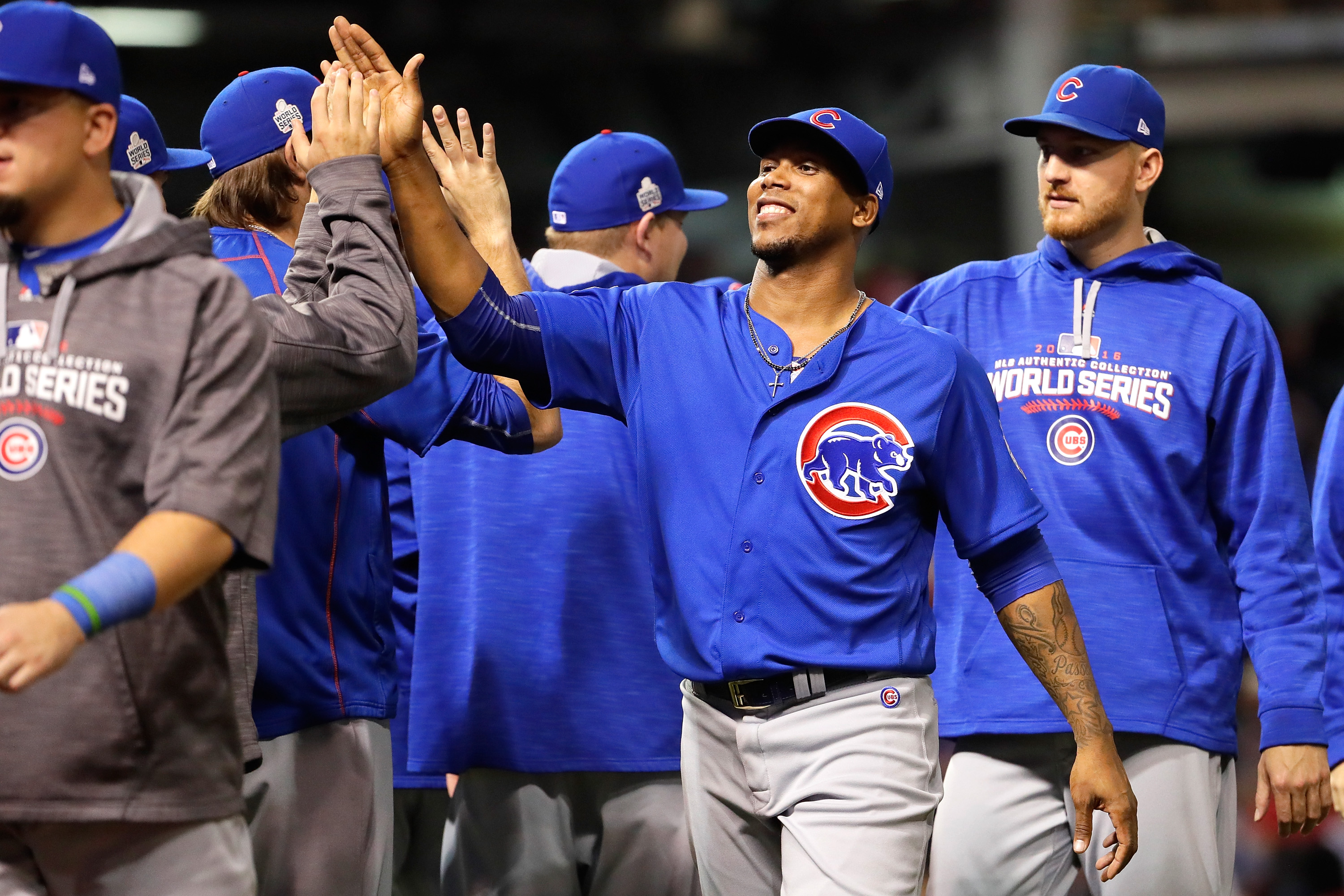 Pedro Strop #46 of the Chicago Cubs high fives teammates after defeating the Cleveland Indians 9-3 to win Game Six of the 2016 World Series at Progressive Field on Nov. 1, in Cleveland.
