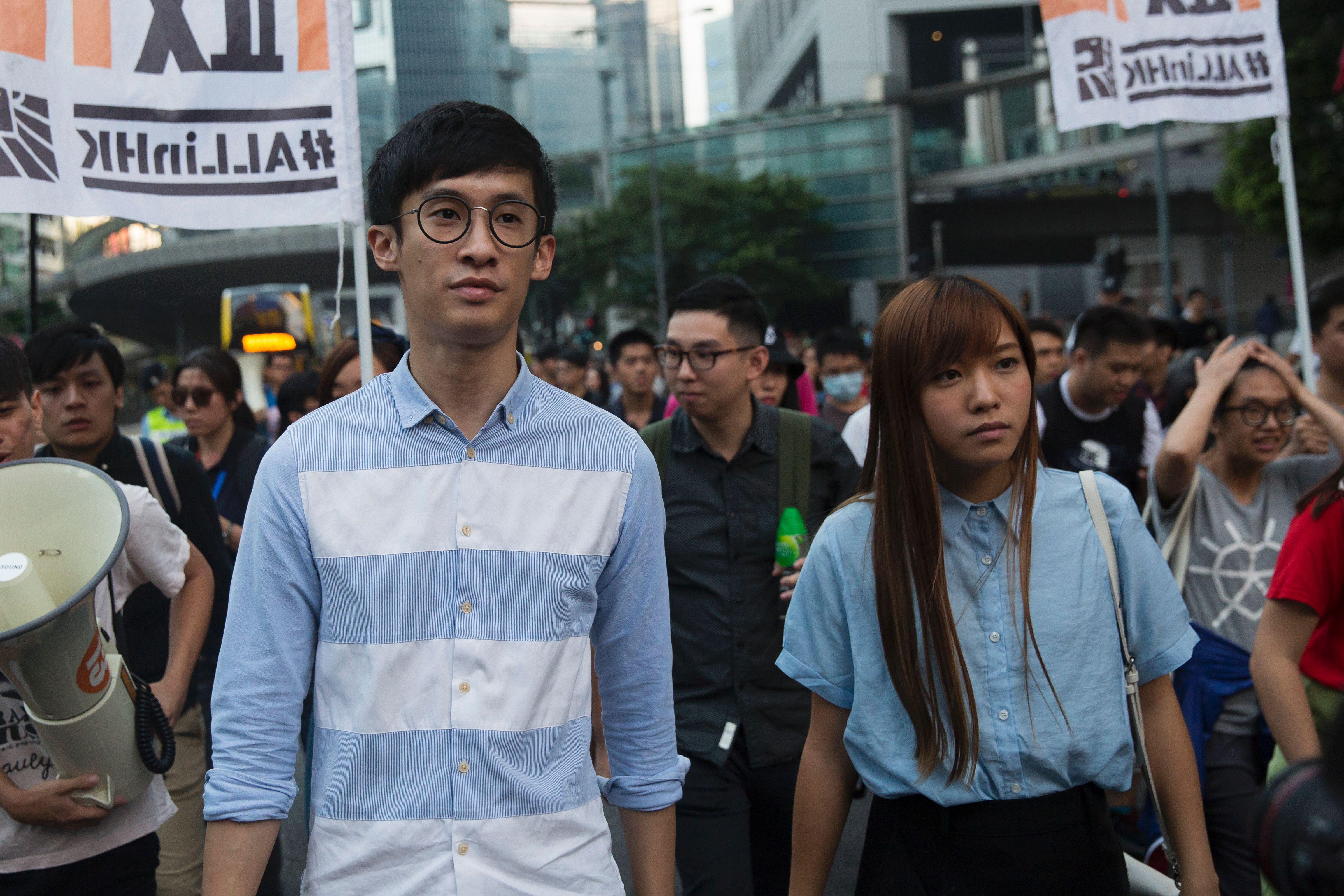 Sixtus  Baggio  Leung, left, and Yau Wai-ching, both elected lawmakers of Youngspiration party, march during a protest in Hong Kong on Nov. 6, 2016