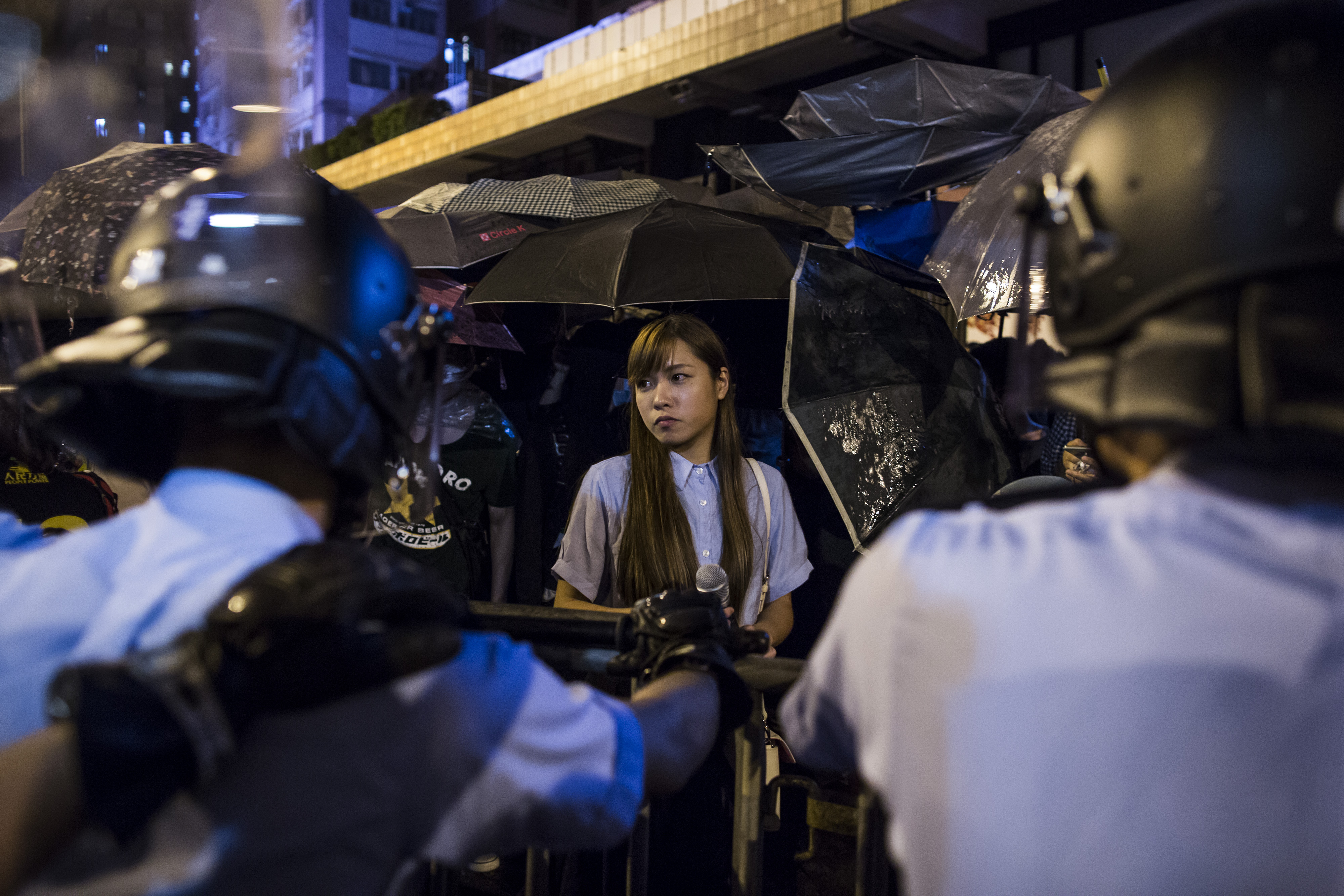 Yau Wai-ching stands among demonstrators during a protest near the Liaison Office of the Central People's Government in Hong Kong on Nov. 6, 2016