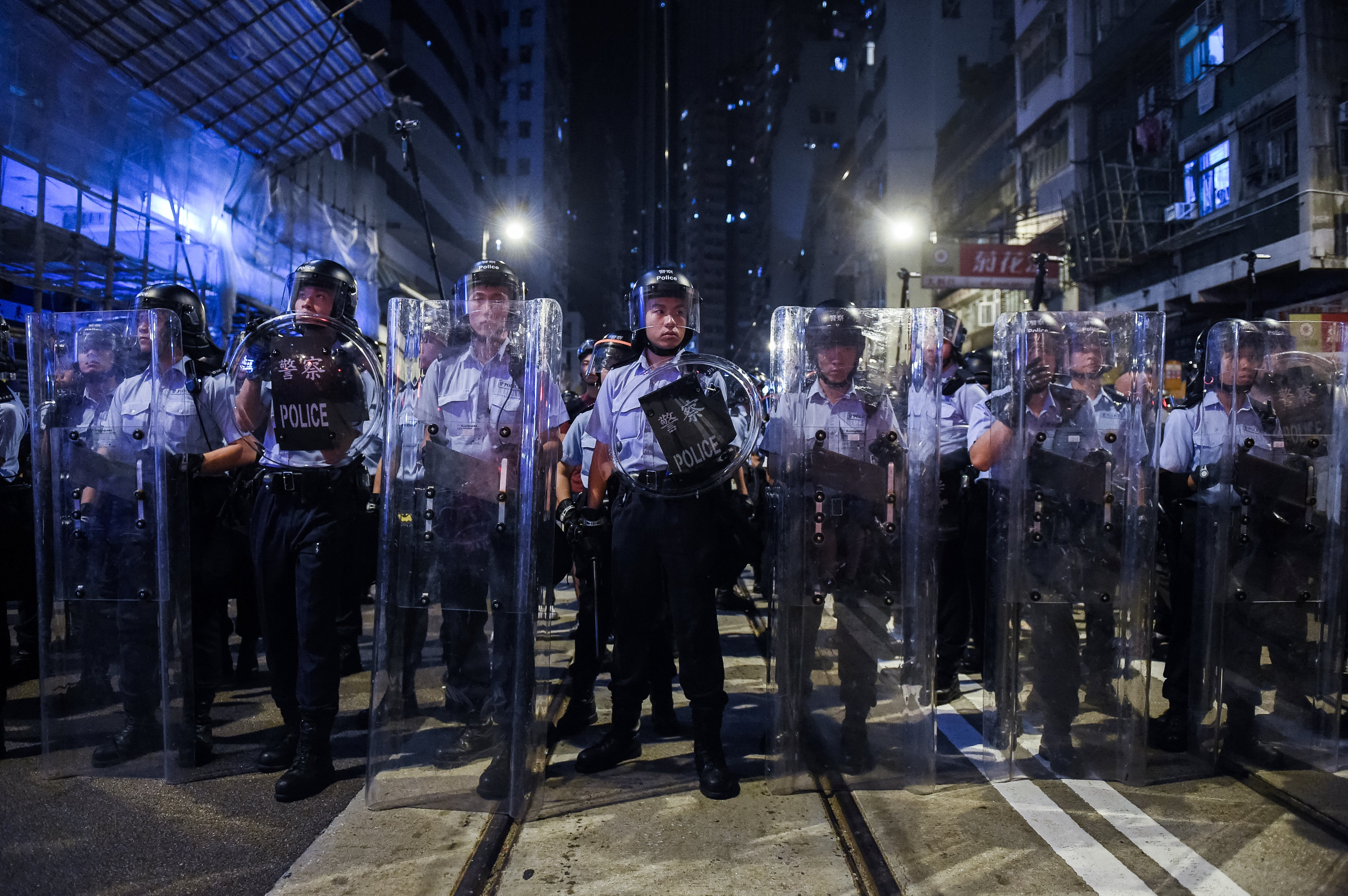 Riot police stand guard during a protest in Hong Kong early on Nov. 7, 2016