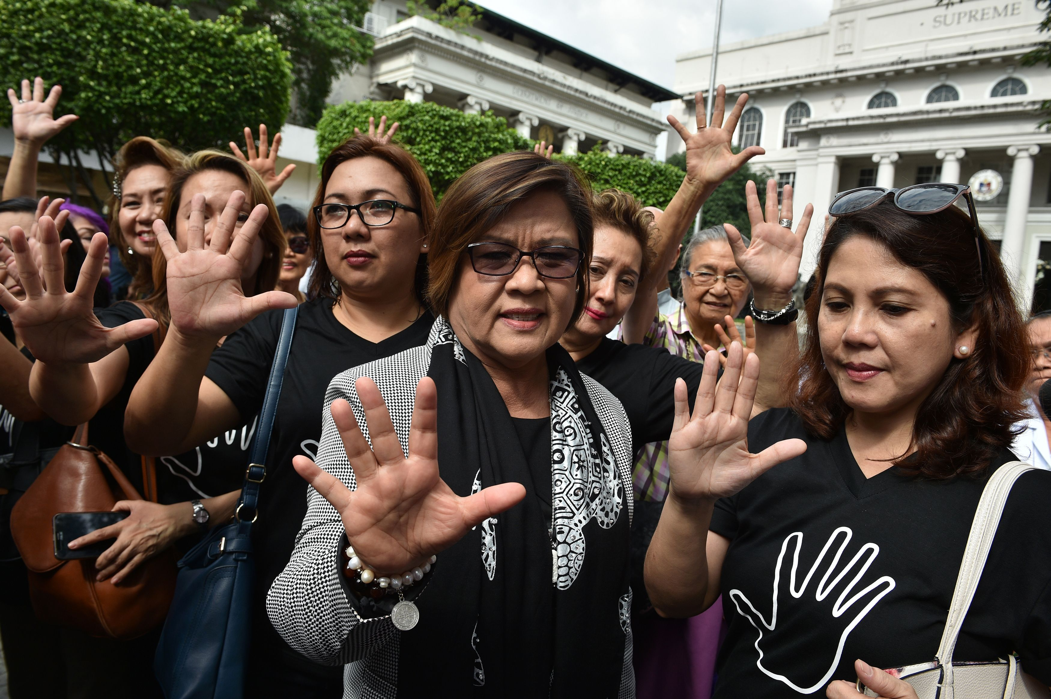 Senator Leila de Lima, center, gestures with supporters after filing her petition for habeas data against Philippine President Rodrigo Duterte at the Supreme Court in Manila on Nov. 7, 2016. De Lima, former Justice Secretary who is a leading critic of Duterte's war on drugs, launched a Senate probe into the surge of killings since Duterte took office on June 30, which led to her being ousted on Sept. 19 by pro-Duterte Senators as head of the Senate justice committee.