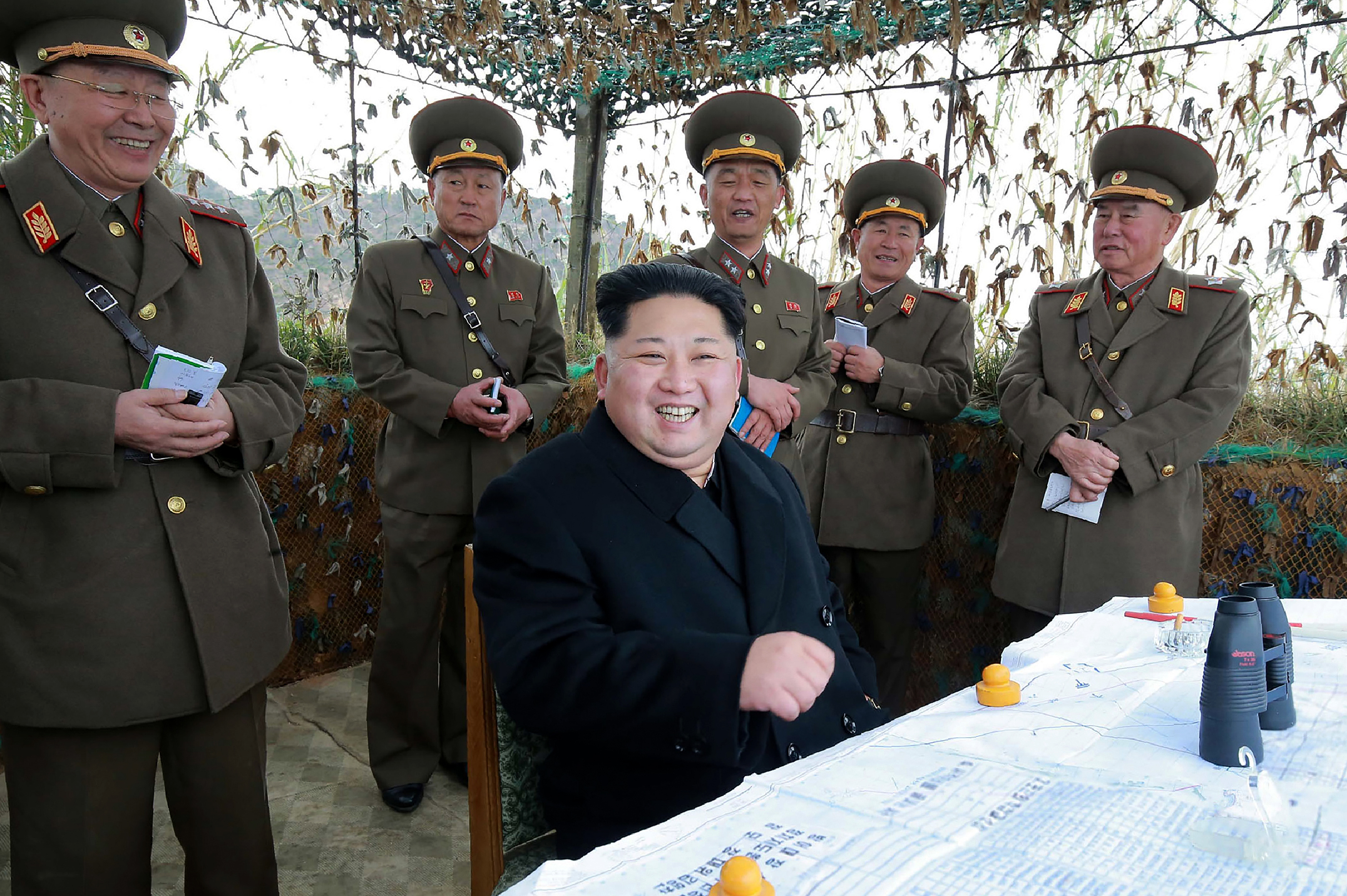 This undated photo released by North Korea's official Korean Central News Agency (KCNA) on November 11, 2016 shows North Korean leader Kim Jong-Un (C) at the defence detachment on Mahap Islet in Ongjin County, South Hwanghae.  China has reportedly banned a nickname that refers to the North Korean leader from its main search engine and social media sites.