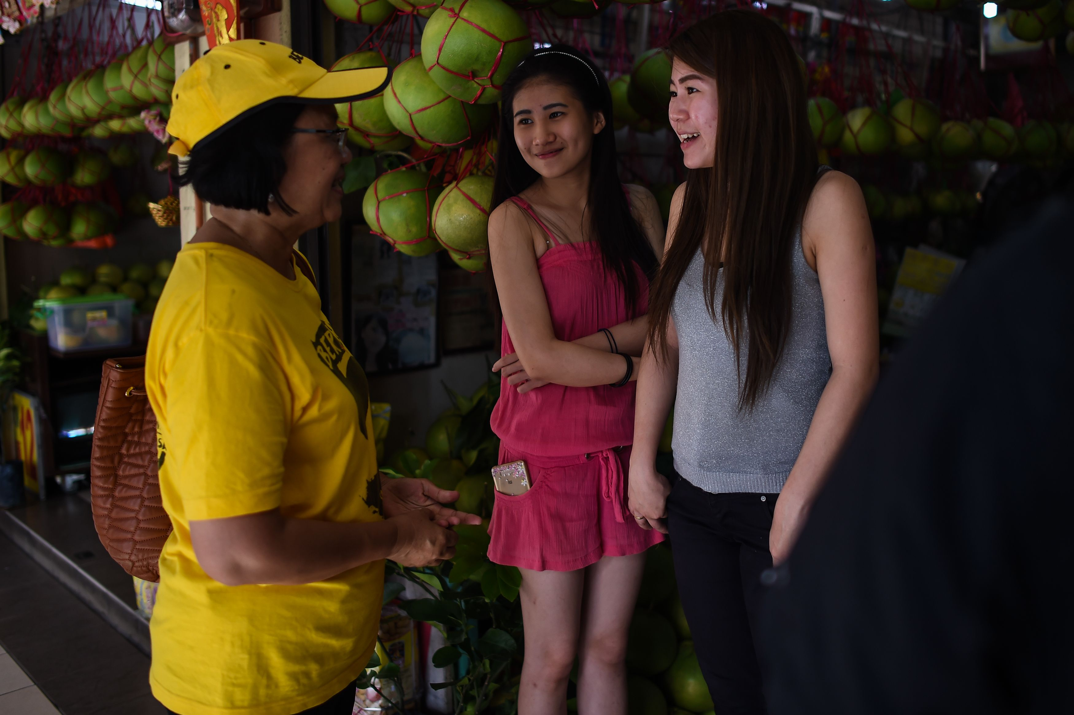 Maria Chin Abdullah, left, chair of civil-society alliance Bersih talks door-to-door and canvasses in the Malaysian town of Ipoh on Nov. 11, 2016, ahead of Bersih's demonstration in the capital Kuala Lumpur to demand Malaysian Prime Minister Najib's resignation