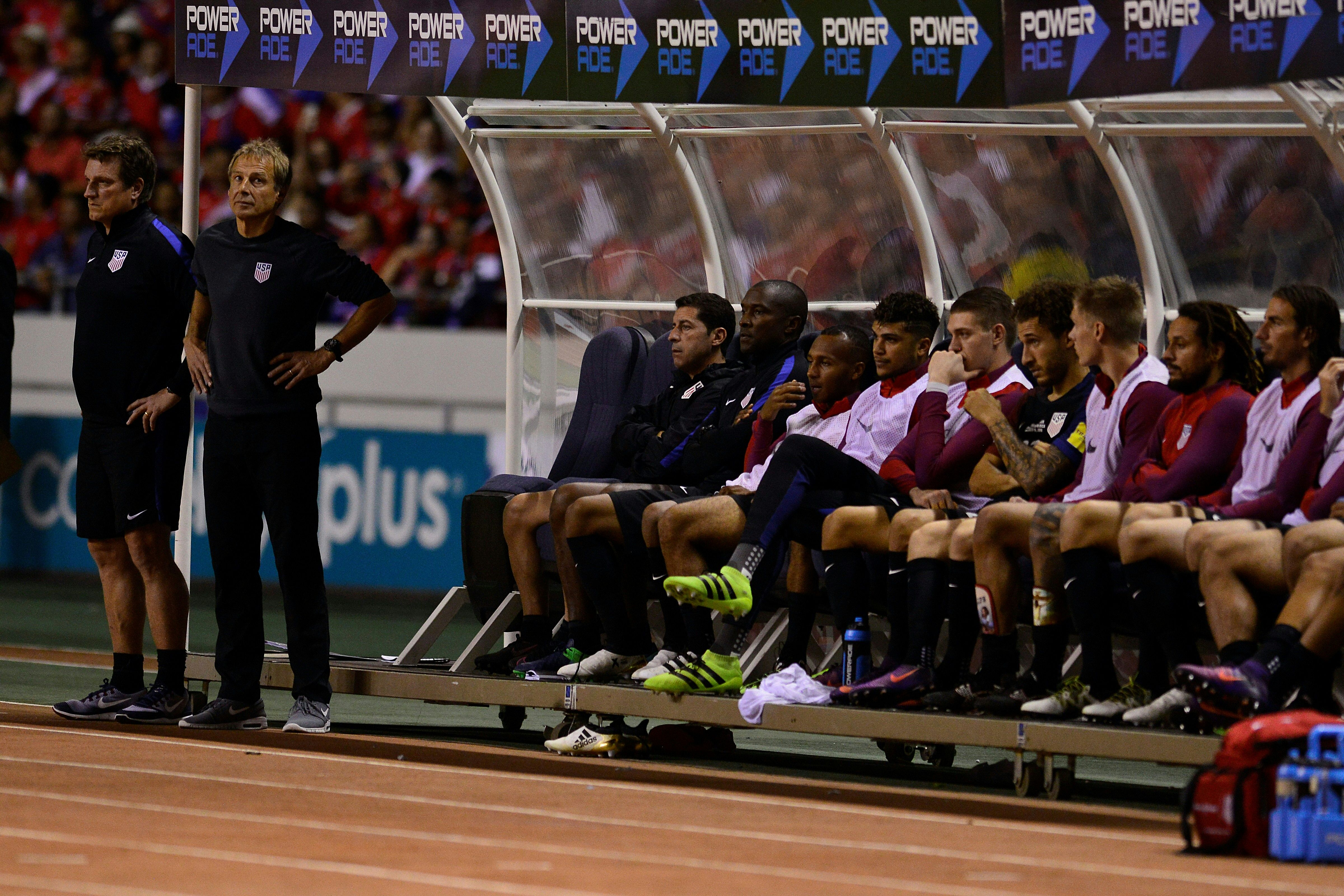United States' players on the bench react during their 2018 FIFA World Cup qualifier football match against Costa Rica, in San Jose, on November 15, 2016.