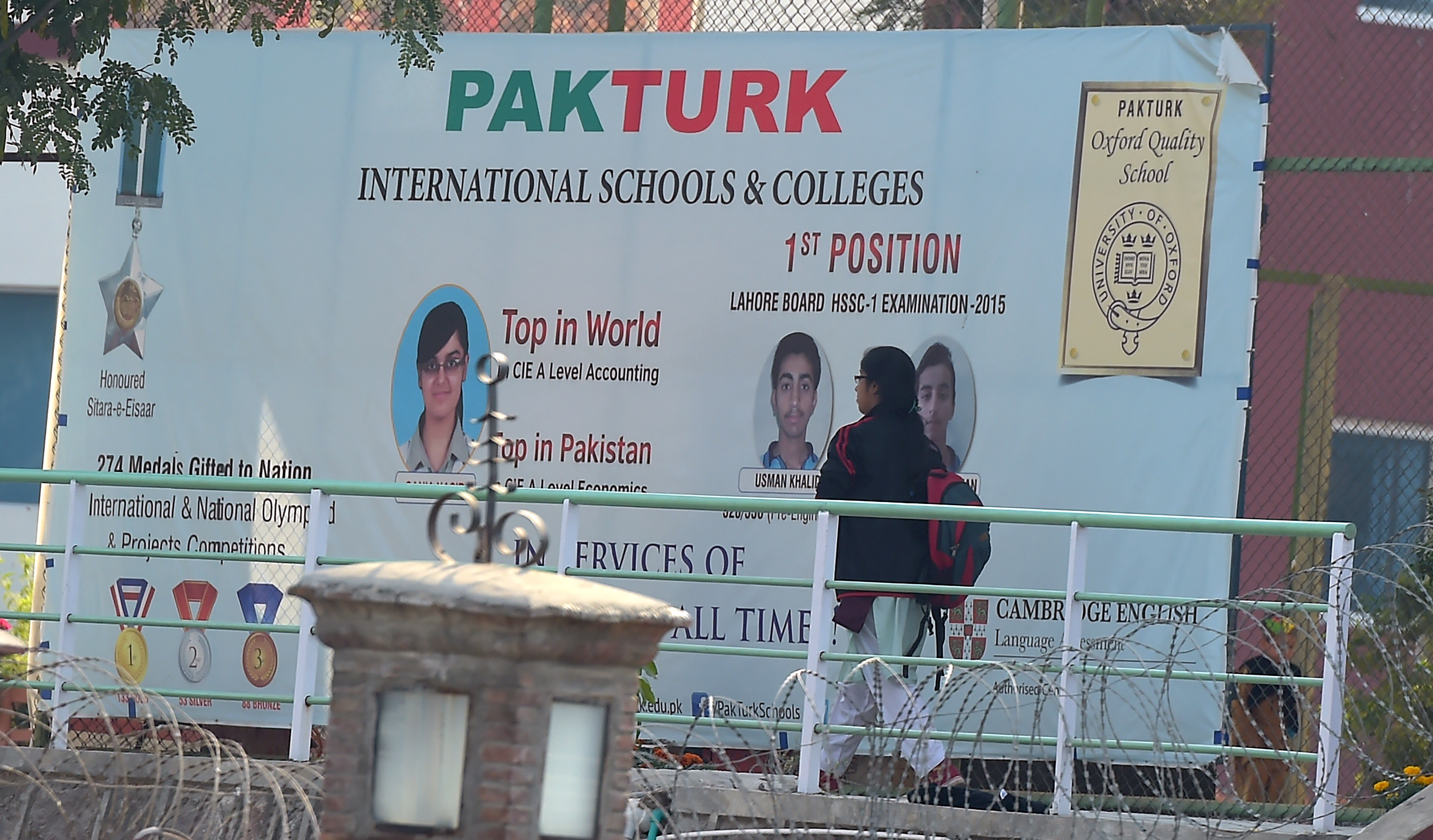 A Pakistani student walks at the private PakTurk International Schools and Colleges in Islamabad on November 16, 2016. Pakistan has ordered the deportation of 130 teachers affiliated with the alleged mastermind of an attempted coup in Turkey, officials said, as Turkish President Recep Tayyip Erdogan was to arrive for a visit.