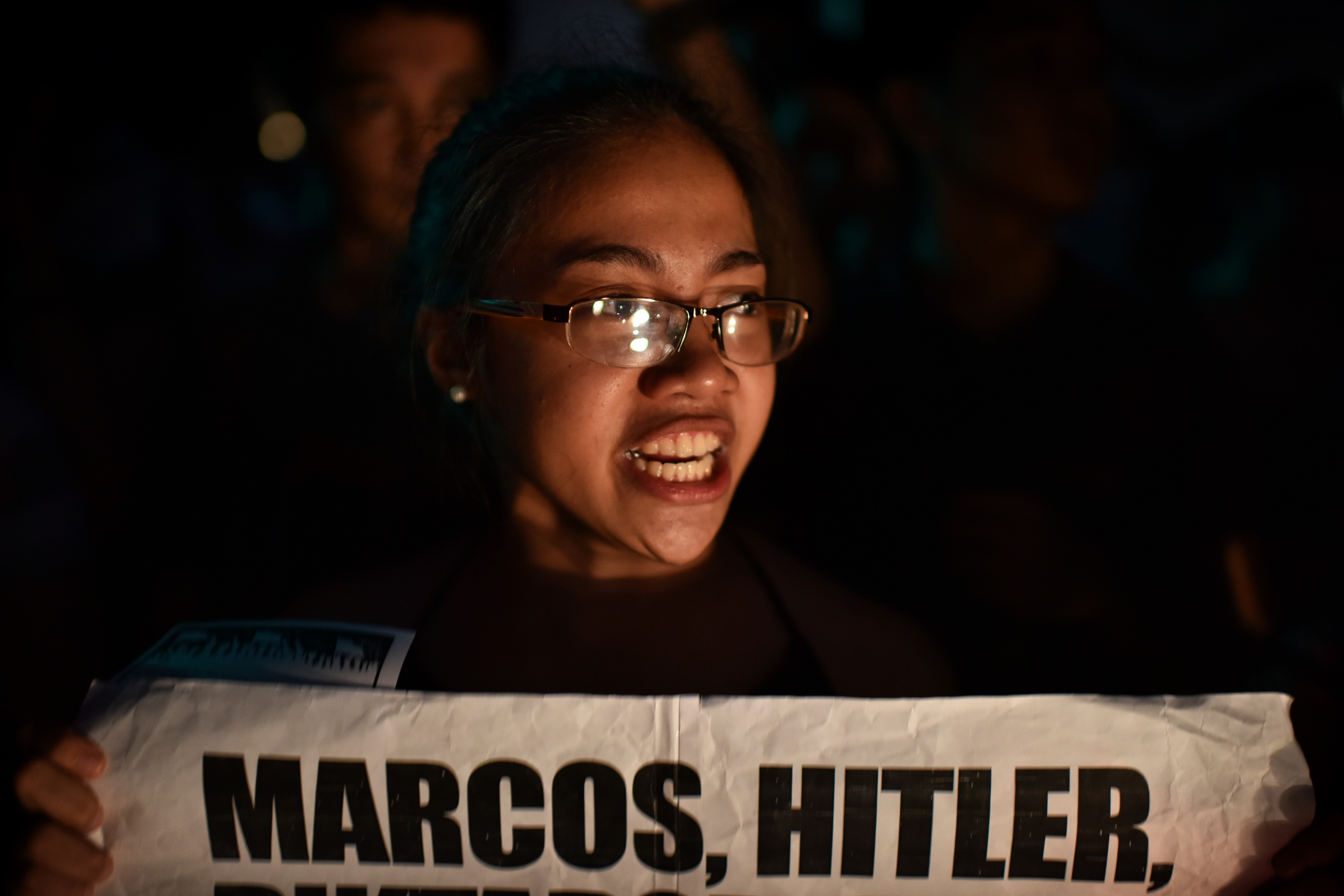 Students and anti-Marcos activists take to the streets of Manila to protest the hero's burial accorded to former Philippine dictator Ferdinand Marcos on Nov. 18, 2016.