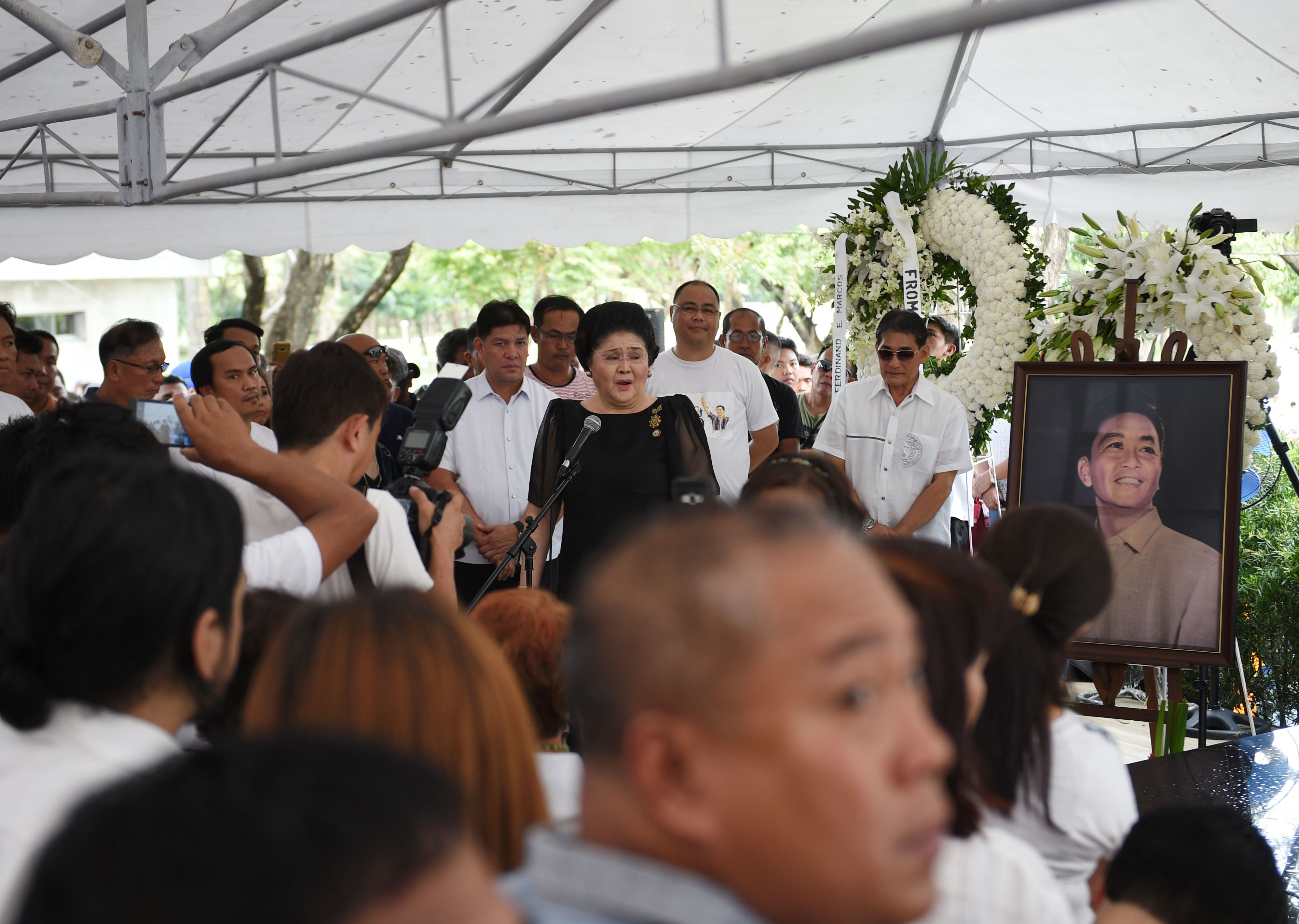 Philippines' former First Lady Imelda Marcos, center, speaks to supporters at the graveyard of the late dictator Ferdinand Marcos at the Heroes' Cemetery in Manila on Nov. 19, 2016, a day after the late dictator was buried.