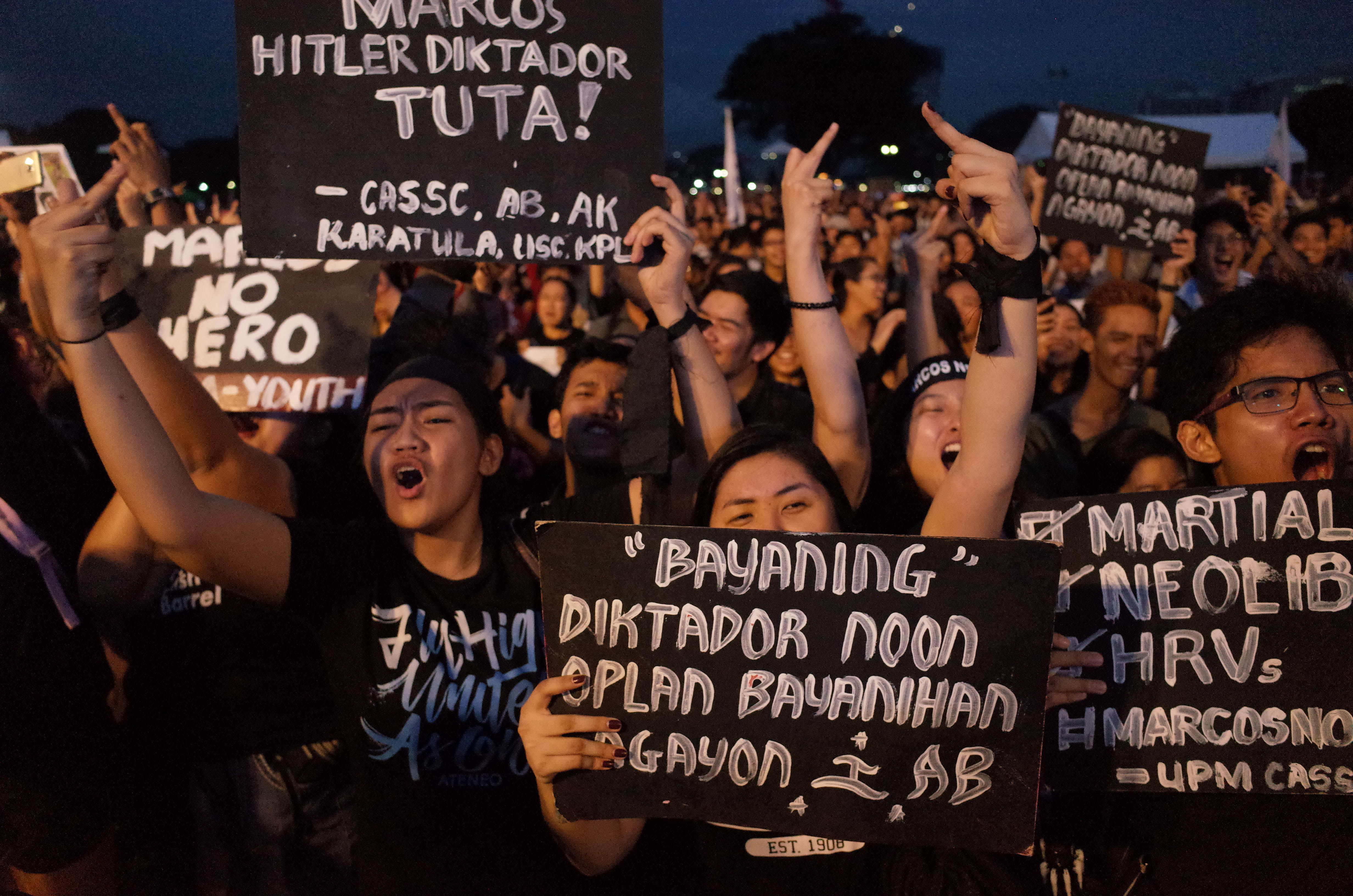 Filipino activists during a rally against the secrecy-shrouded burial of late Philippine president Ferdinand Marcos at the Heroes' Cemetery on November 18, 2016.