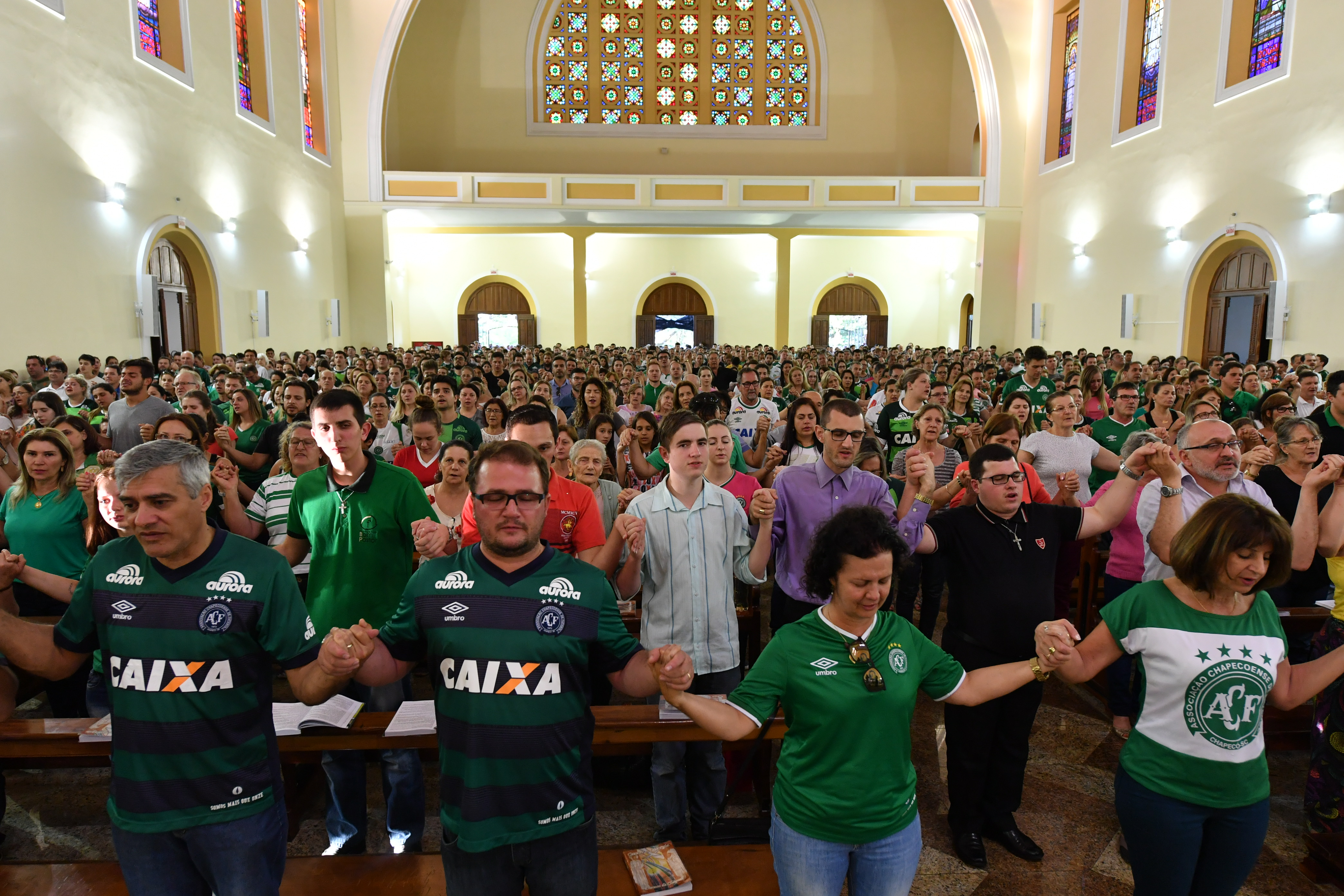 People attend a mass in memoriam of the players of Brazilian team Chapecoense Real killed in a plane crash in the Colombian mountains, in Chapeco, in the southern Brazilian state of Santa Catarina, on November 29, 2016.