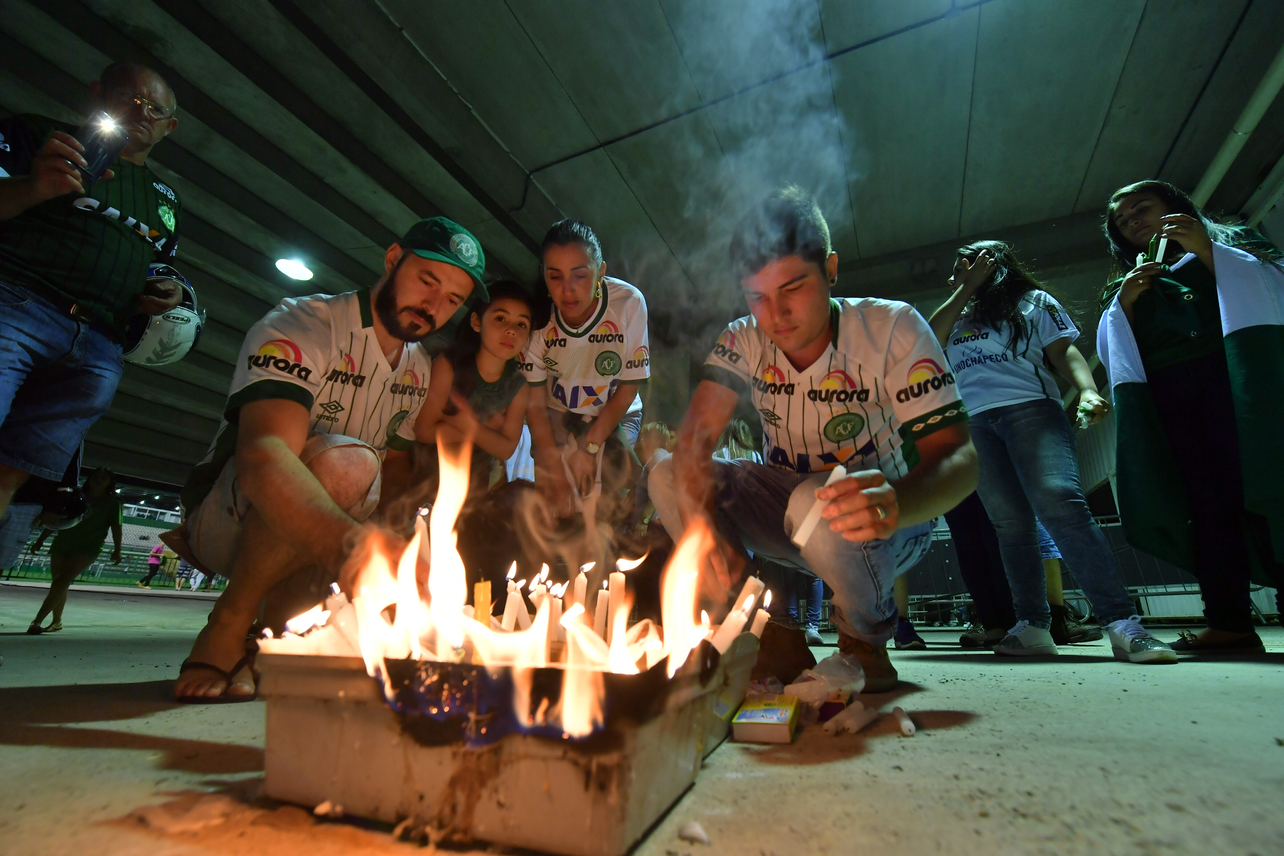 Fans light candles in tribute to the players of Brazilian team Chapecoense Real killed in a plane crash in the Colombian mountains, at their football stadium in Chapeco, Santa Catarina, Brazil on November 29, 2016.
